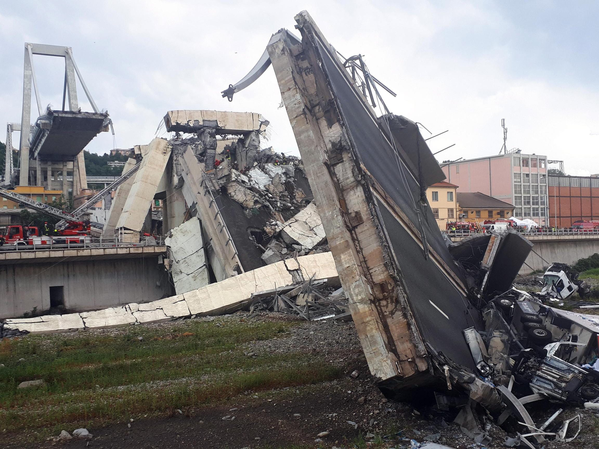 Aug. 14, 2018: Rescuers at work amid the rubble after a highway bridge collapsed in Genoa, Italy. A large section of the Morandi viaduct upon which the A10 motorway runs collapsed in Genoa on early Aug. 14. Several people have died, rescue sources said, as both sides of the highway fell. The viaduct gave way amid torrential rain.