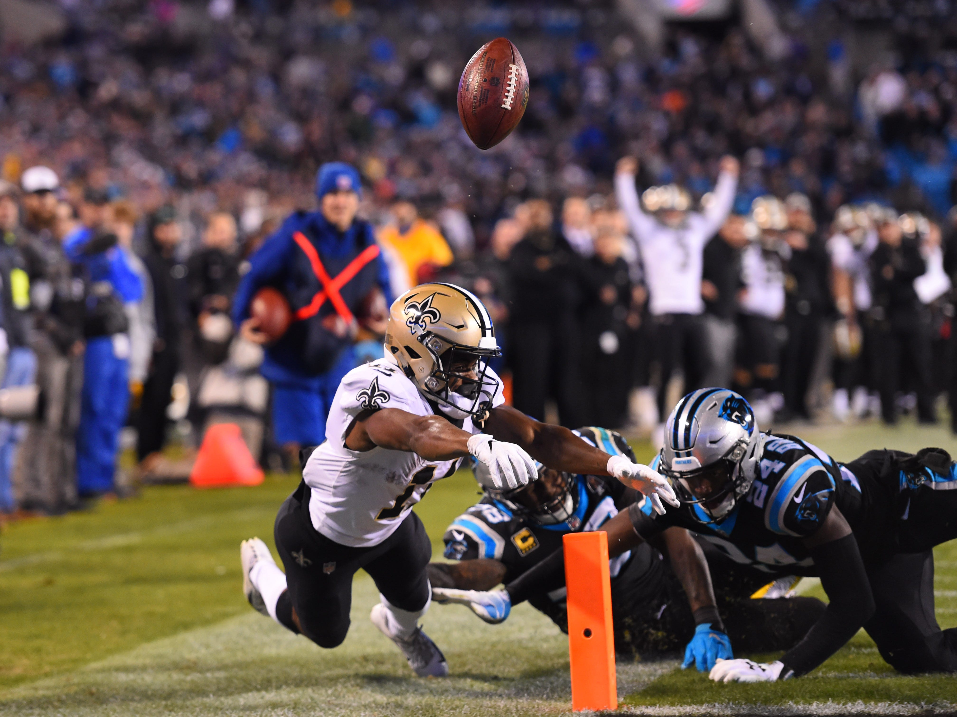 Carolina Panthers cornerback James Bradberry (24) forces a fumble by New Orleans Saints wide receiver Tommylee Lewis (11) at the goal line as outside linebacker Thomas Davis (58) helps defend in the fourth quarter at Bank of America Stadium. The fumble went out of the end zone turning the ball over to the Panthers.