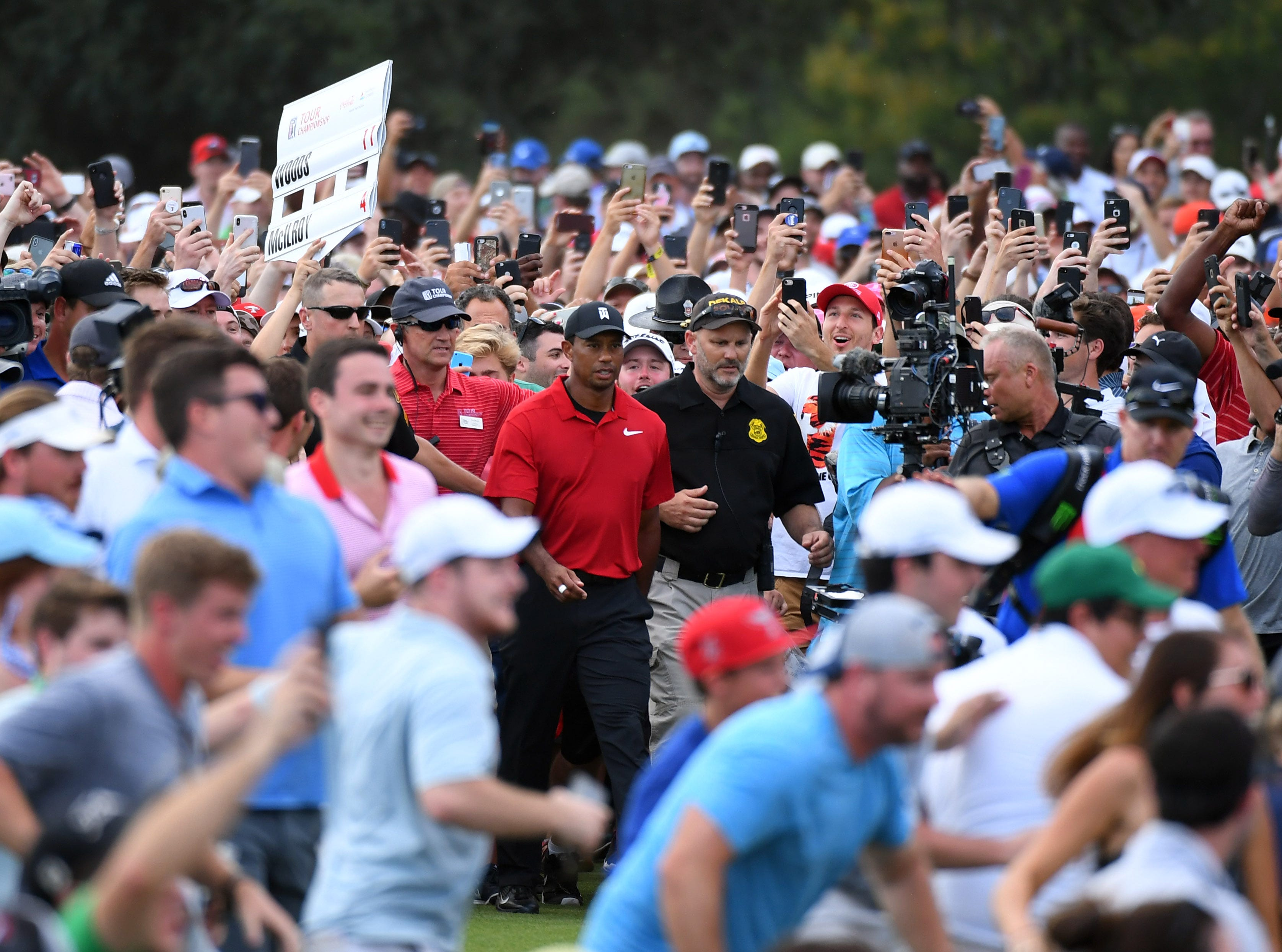 The crowd follows Tiger Woods down the 18th green during the final round of the Tour Championship golf tournament at East Lake Golf Club on Sep 23, 2018 in Atlanta, Ga.  Tiger Woods won the Tour Championship by two shots for his first victory in five years.