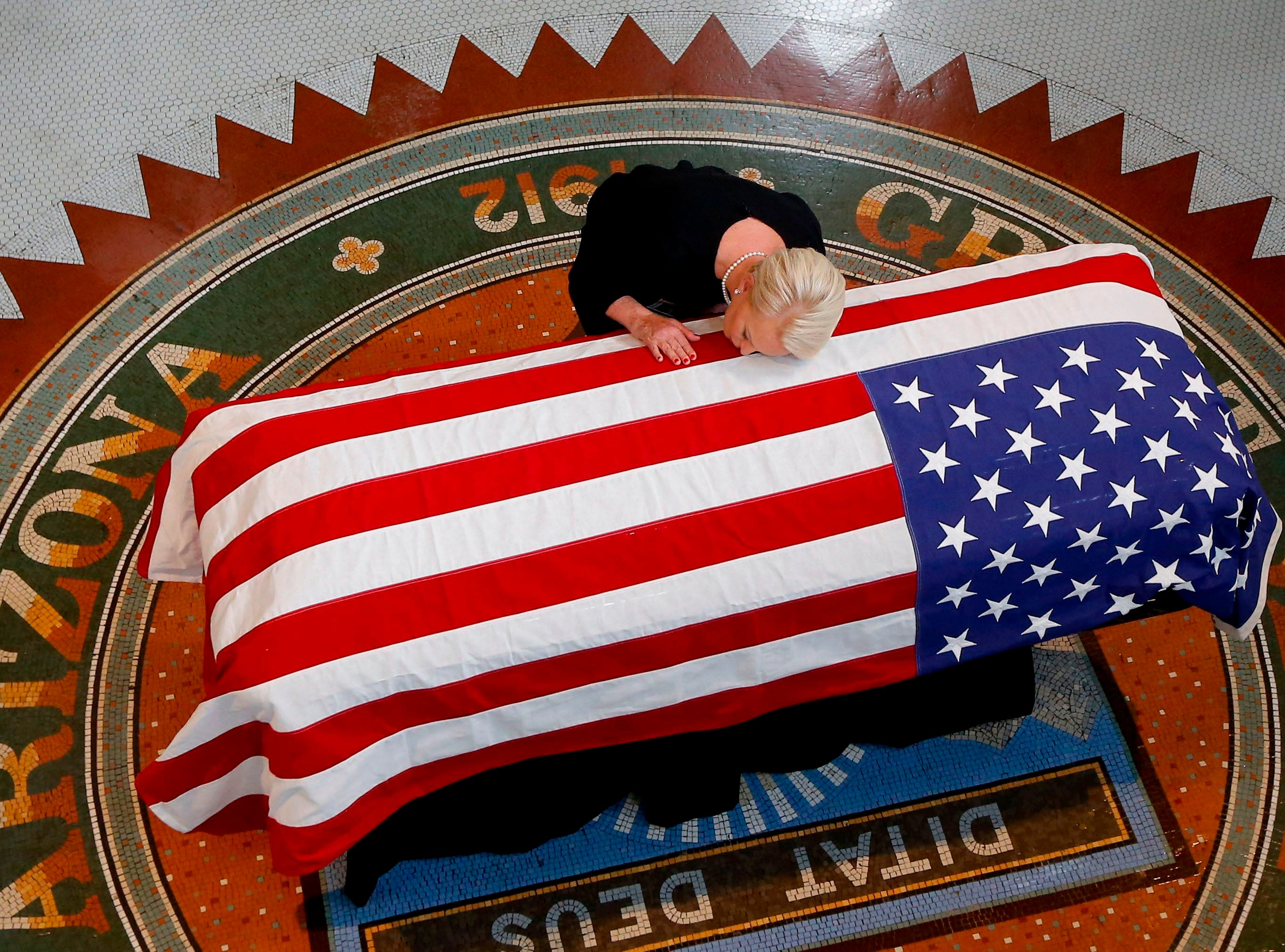 Aug. 29, 2018: Cindy McCain, wife of Senator John McCain, kisses his casket during a memorial service at the Arizona Capitol in Phoenix.