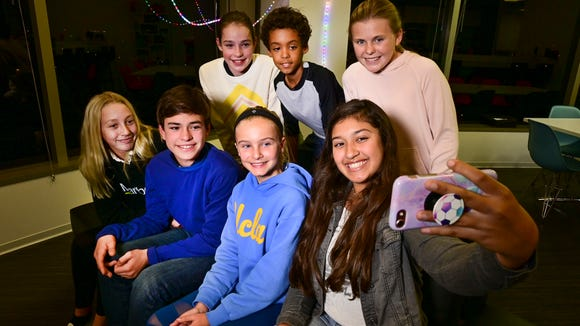 Left to right: Lachlan Cobb 12, Kathi Keller, 12, Tate Cobb, 11, Hannah Amalfi, 11, Christopher Gurdal, 7, Ella Naidoo, 12, and Tatum Krupin, 11 take a group selfie after talking tech with USA TODAY's Jefferson Graham.