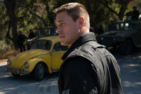 "John Cena wears military gear and a scowl as Agent Burns in ""Bumblebee."""