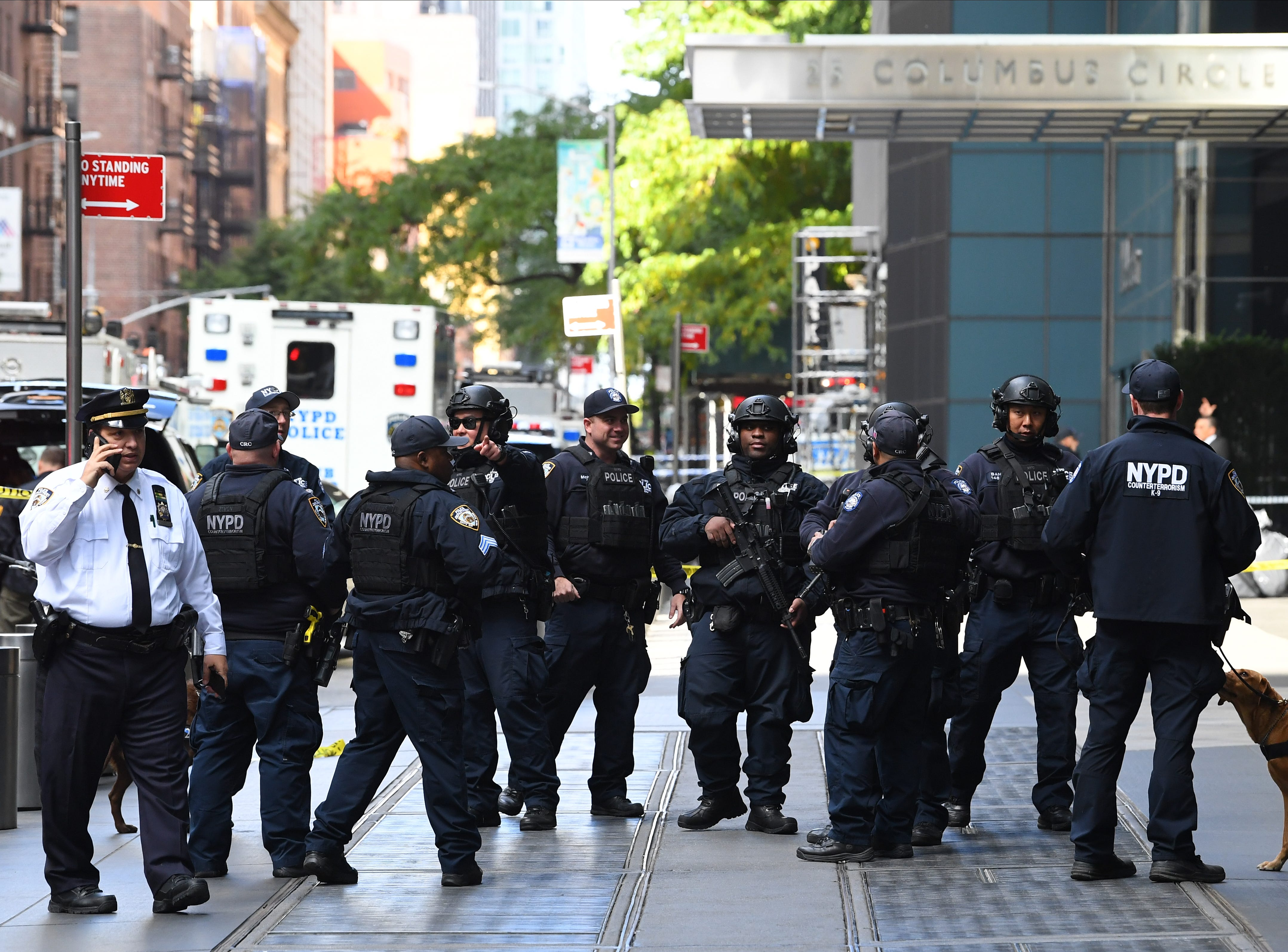 New York City Police Dept. officers gather outside the Time Warner Center, in New York, Oct. 24, 2018. A police bomb squad was sent to CNN's offices in New York City and the newsroom was evacuated because of a suspicious package.
