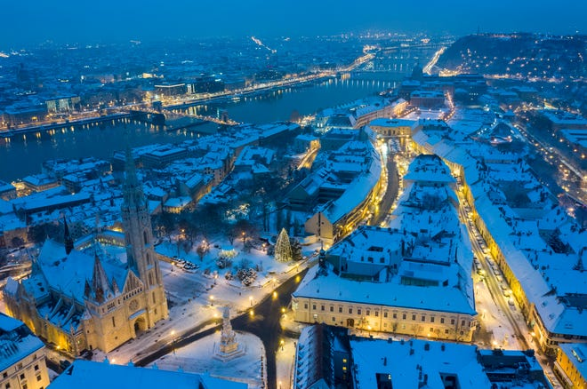 An image taken with a drone shows an aerial view of snow covered Budapest, Hungary, early Dec. 16, 2018 on both sides of River Danube.