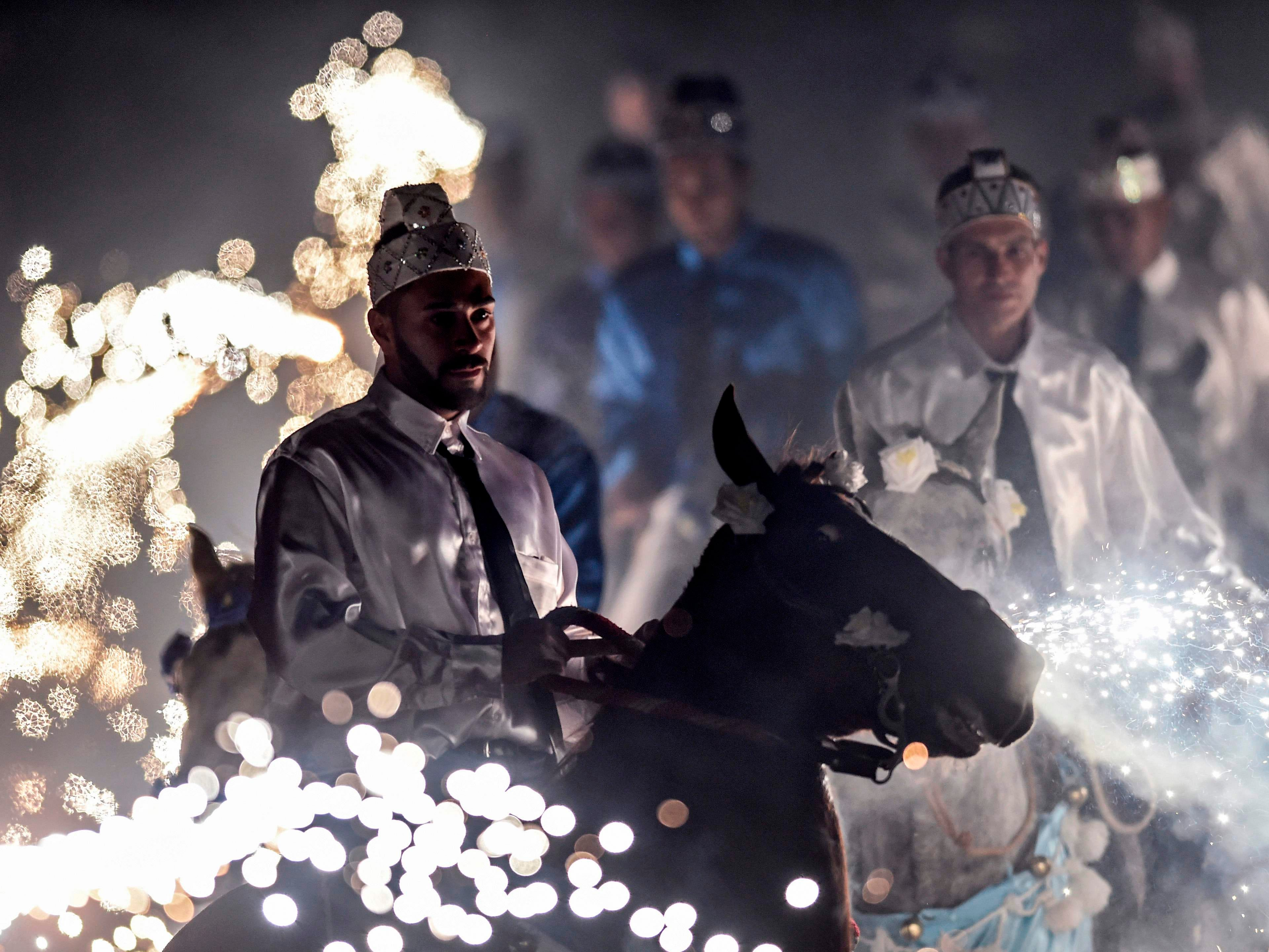 Sept. 7, 2018: Men atop horses take part in Our Lady of Nazareth traditional cavalcade in Morro Vermelho, Brazil. The annual cavalcade, which dates back over 300 years, represents the fight between Christians and Moors, celebrating the victory of Christians.