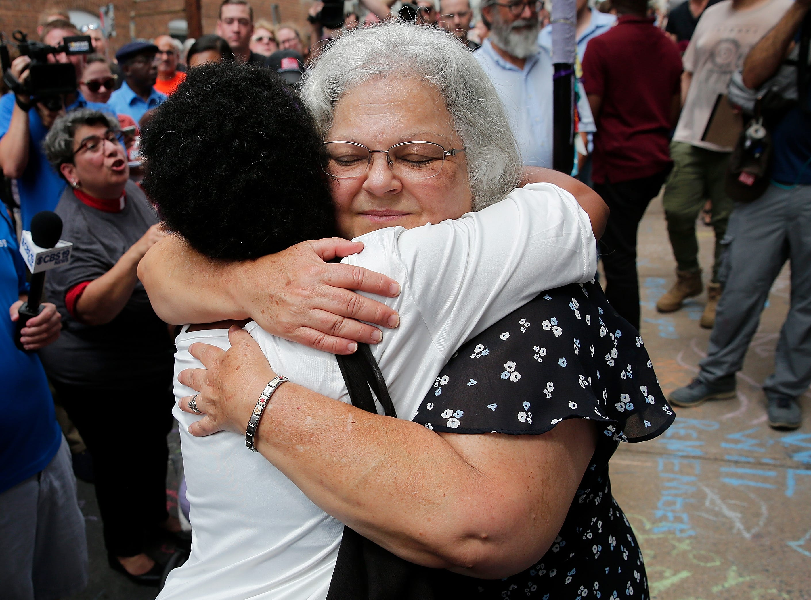 Aug. 12, 2018: Susan Bro (R), mother of Heather Heyer, hugs a young woman near a makeshift memorial for her daughter Heather who was killed one year ago during a deadly clash in Charlottesville, Va. Charlottesville has been declared in a state of emergency by Virginia Gov. Ralph Northam as the city braces for the one year anniversary of the deadly clash between white supremacist forces and counter protesters over the potential removal of Confederate statues of Robert E. Lee and Jackson.