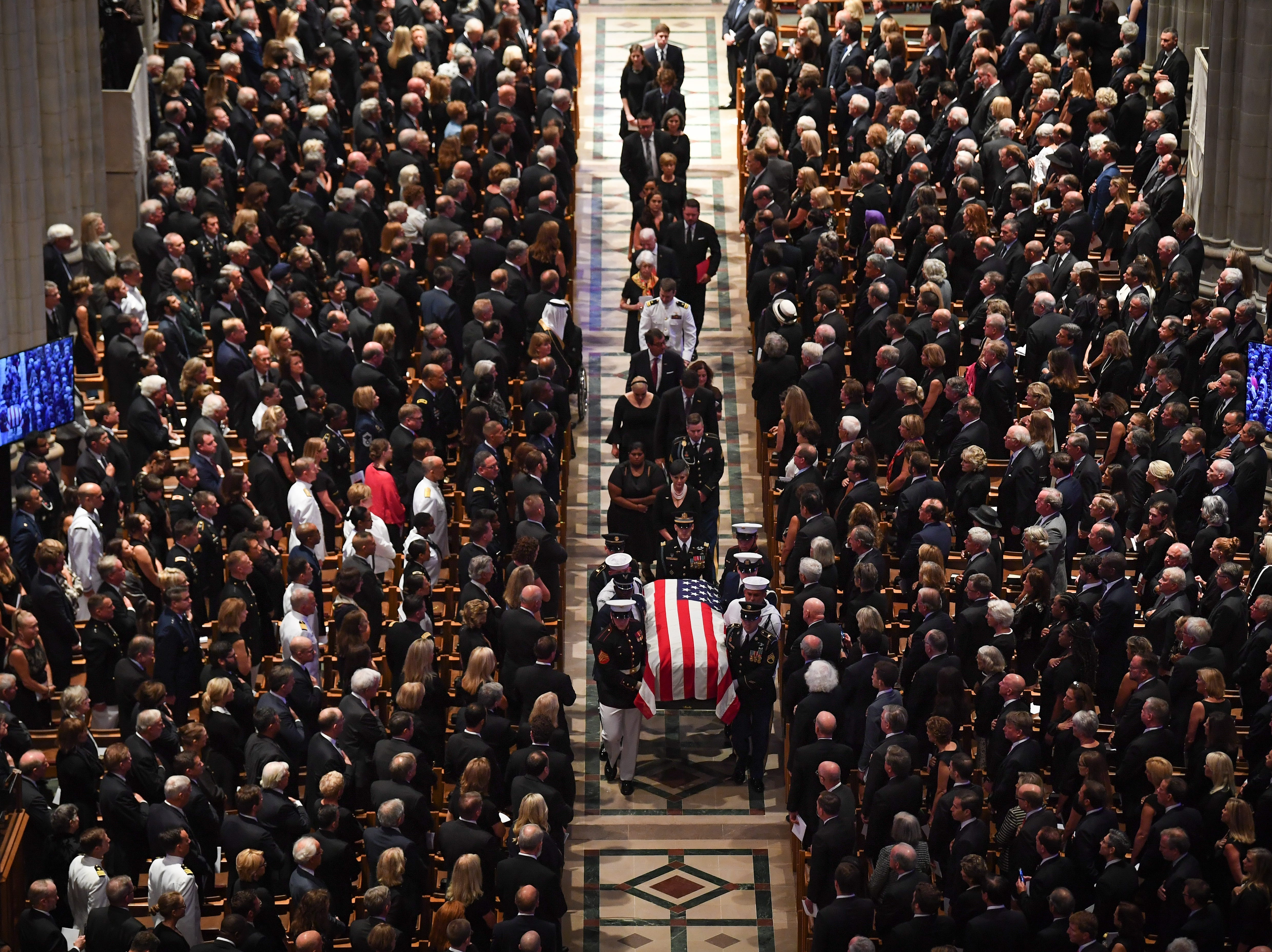 Sept. 1, 2018: Cindy McCain follows the casket of her husband at the conclusion of the memorial service for John McCain at the National Cathedral in Washington.