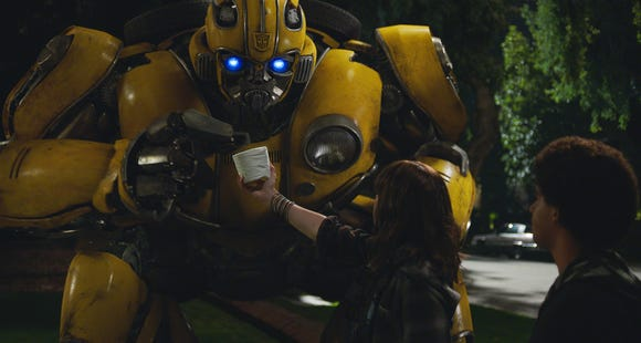 Bumblebee engages in some late-night shenanigans with new pals Charlie (Hailee Steinfeld) and Memo (Jorge Lendeborg Jr.).