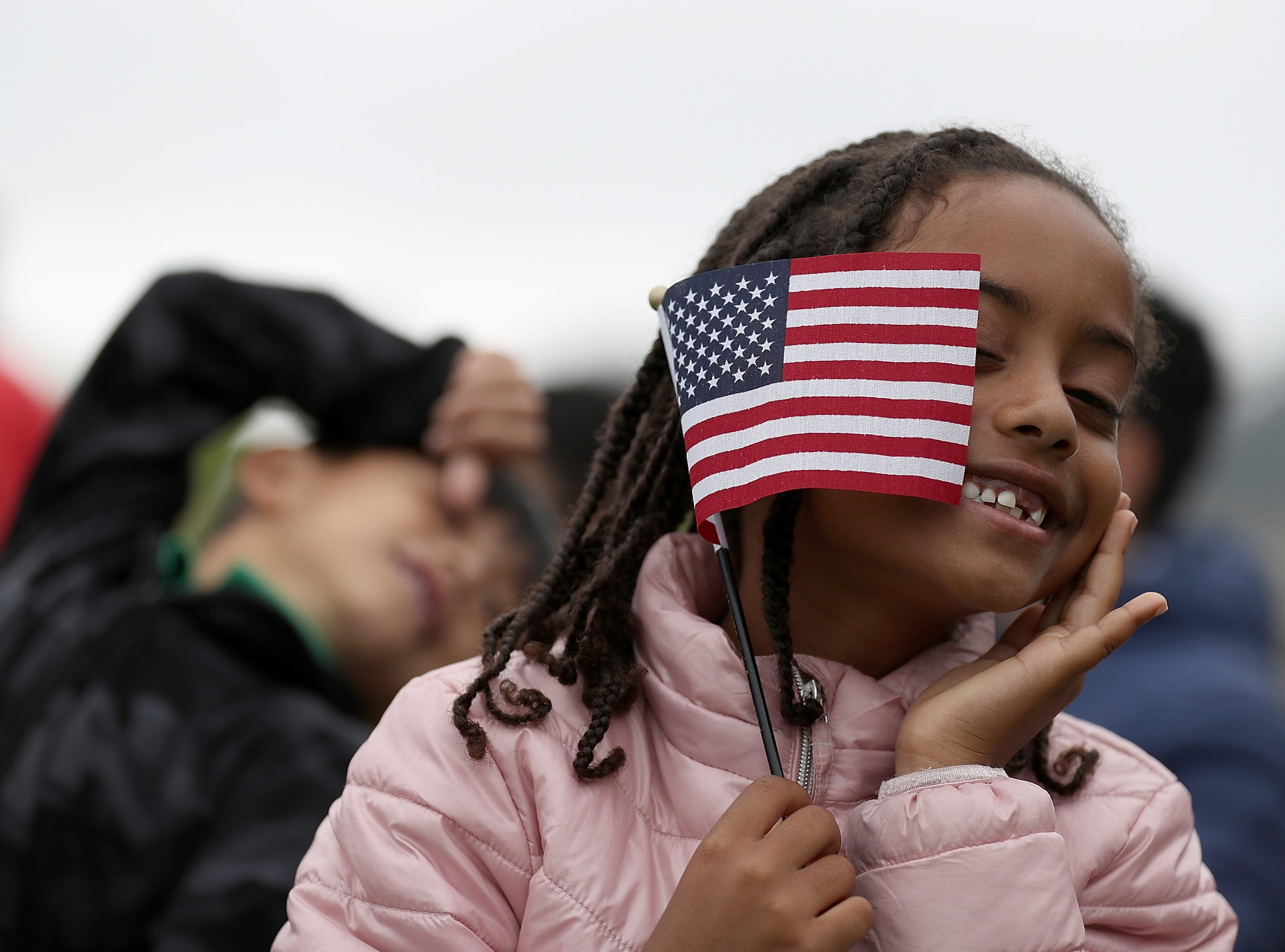 Aug. 17, 2018: Sophia Biniam, 7, holds an American flag during a naturalization ceremony for kids between the ages of 6-12 at Crissy Field near the Golden Gate Bridge in San Francisco, Calif. Thirty-two children from seven countries were sworn in as U.S. citizens during a special naturalization ceremony.