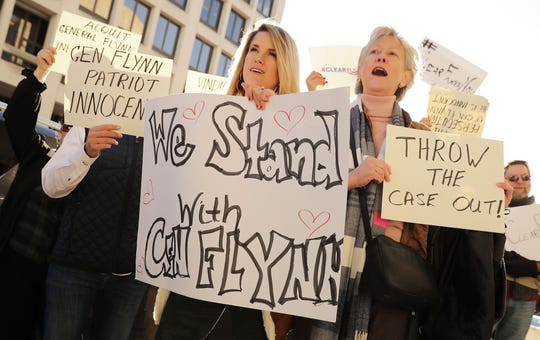"""Supporters of former national security adviser Michael Flynn sing """"God Bless America"""" as they rally for him before Flynn is sentenced in U.S. District Court for lying to the FBI about his communication with former Russian Ambassador Sergey Kislyak, Dec. 18, 2018, in Washington."""