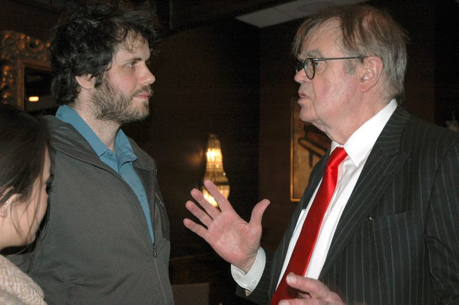 """In this Sunday, Dec. 16, 2018, former """"A Prairie Home Companion"""" host Garrison Keillor, right, talks to fans after his performances at Crooners lounge in Fridley, Minn."""