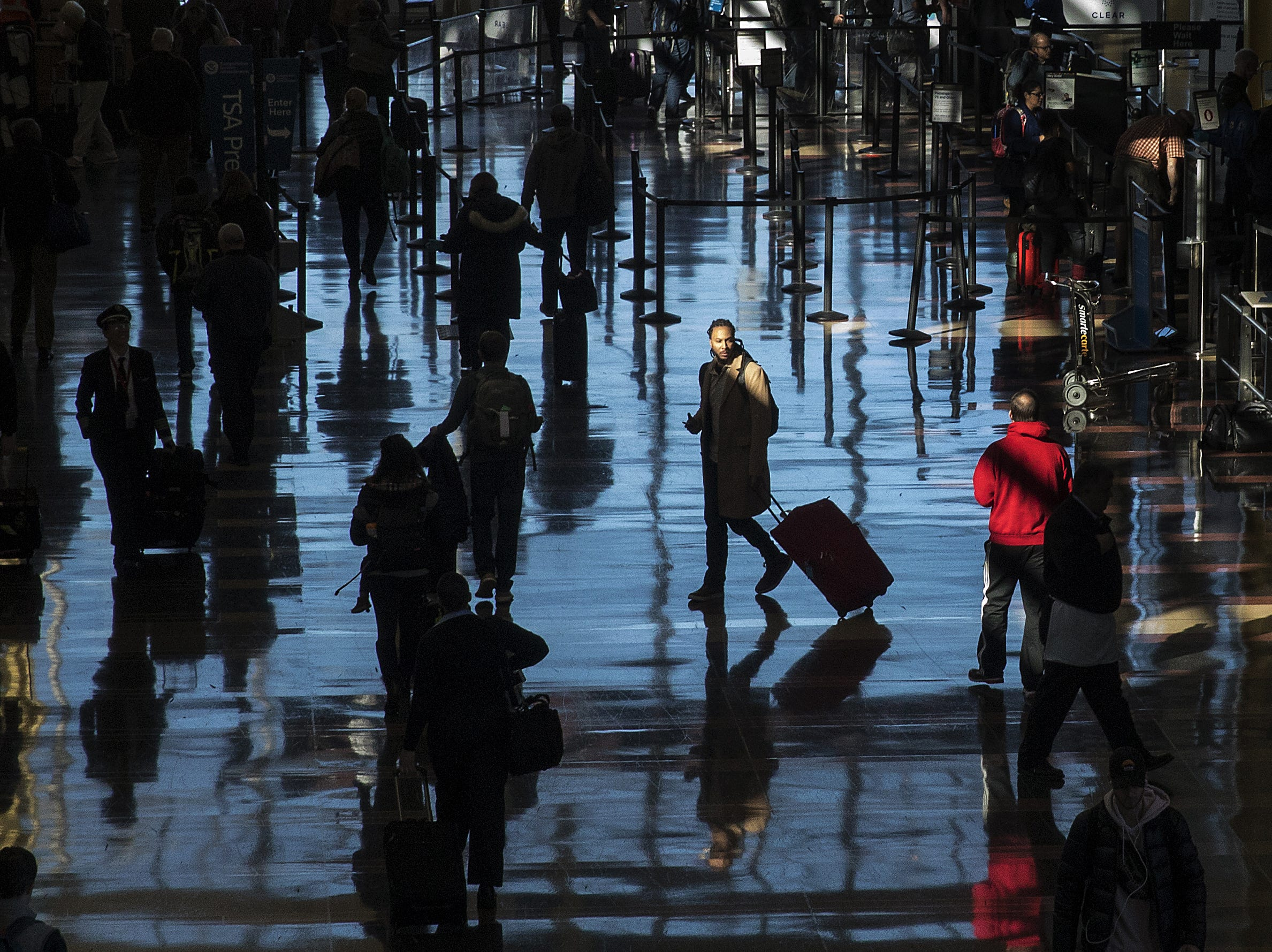 Passengers move through Ronald Reagan National Airport on the day before Thanksgiving, Nov. 21, 2018 in Washington, DC.