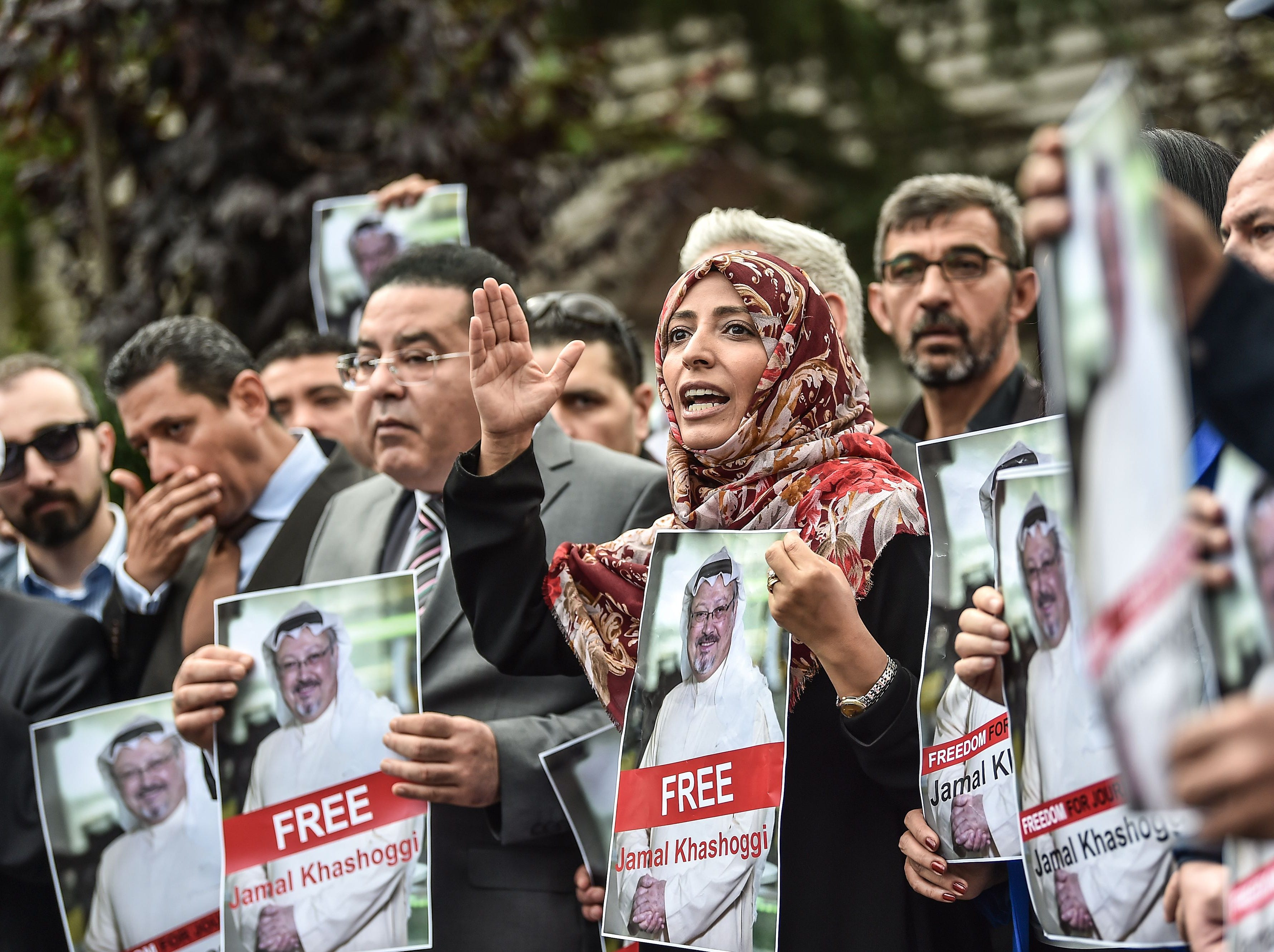 Nobel Peace Prize laureate Yemeni Tawakkol Karman (R), flanked by Egytian opposition politican Ayman Nour (L), holds pictures of missing journalist Jamal Khashoggi during a demonstration in front of the Saudi Arabian consulate on Oct. 8, 2018 in Istanbul.