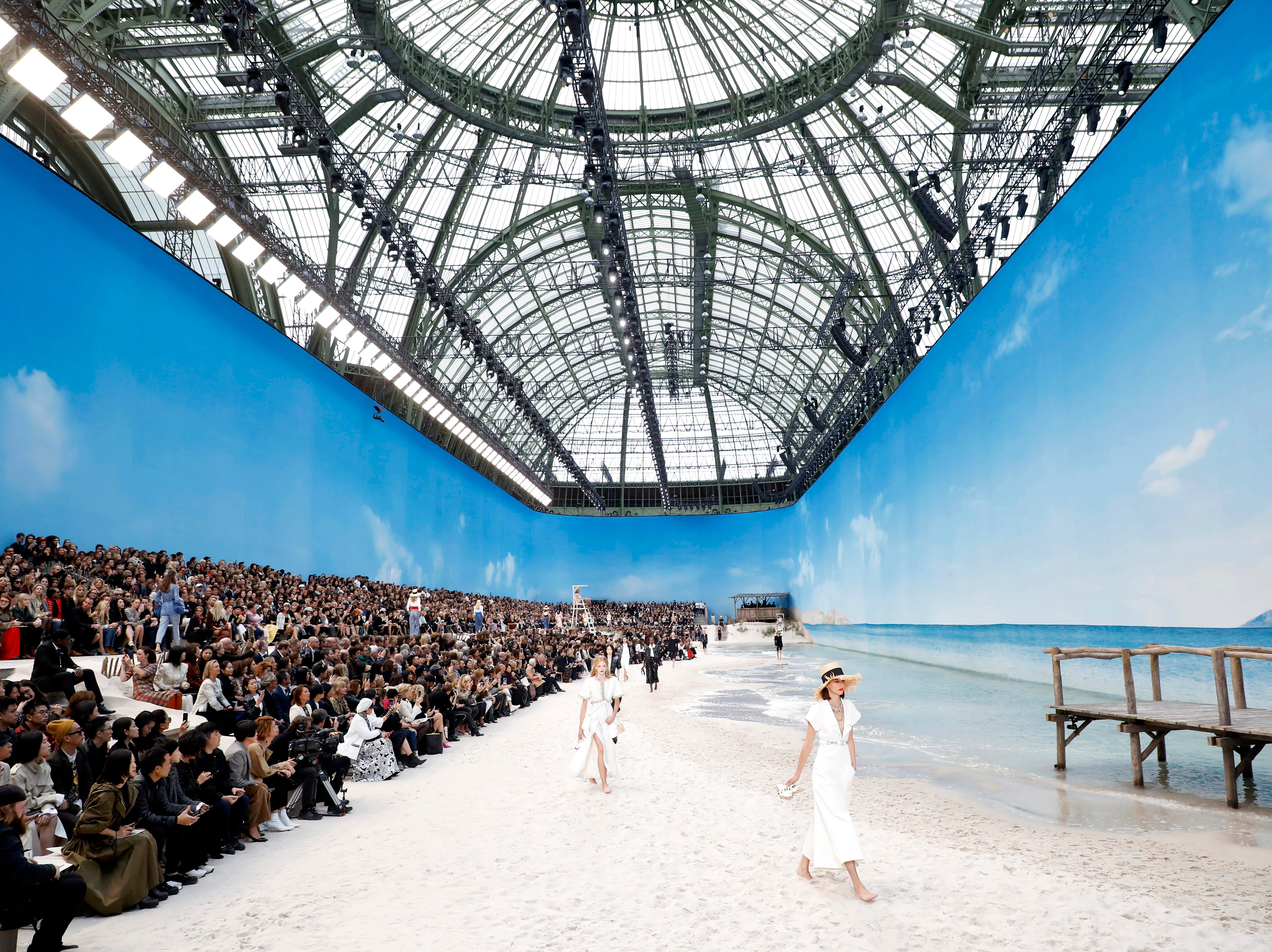 Models present creations from the Spring/Summer 2019 Women's collection by German designer Karl Lagerfeld for Chanel at the Grand Palais during Paris Fashion Week on Oct. 2, 2018.