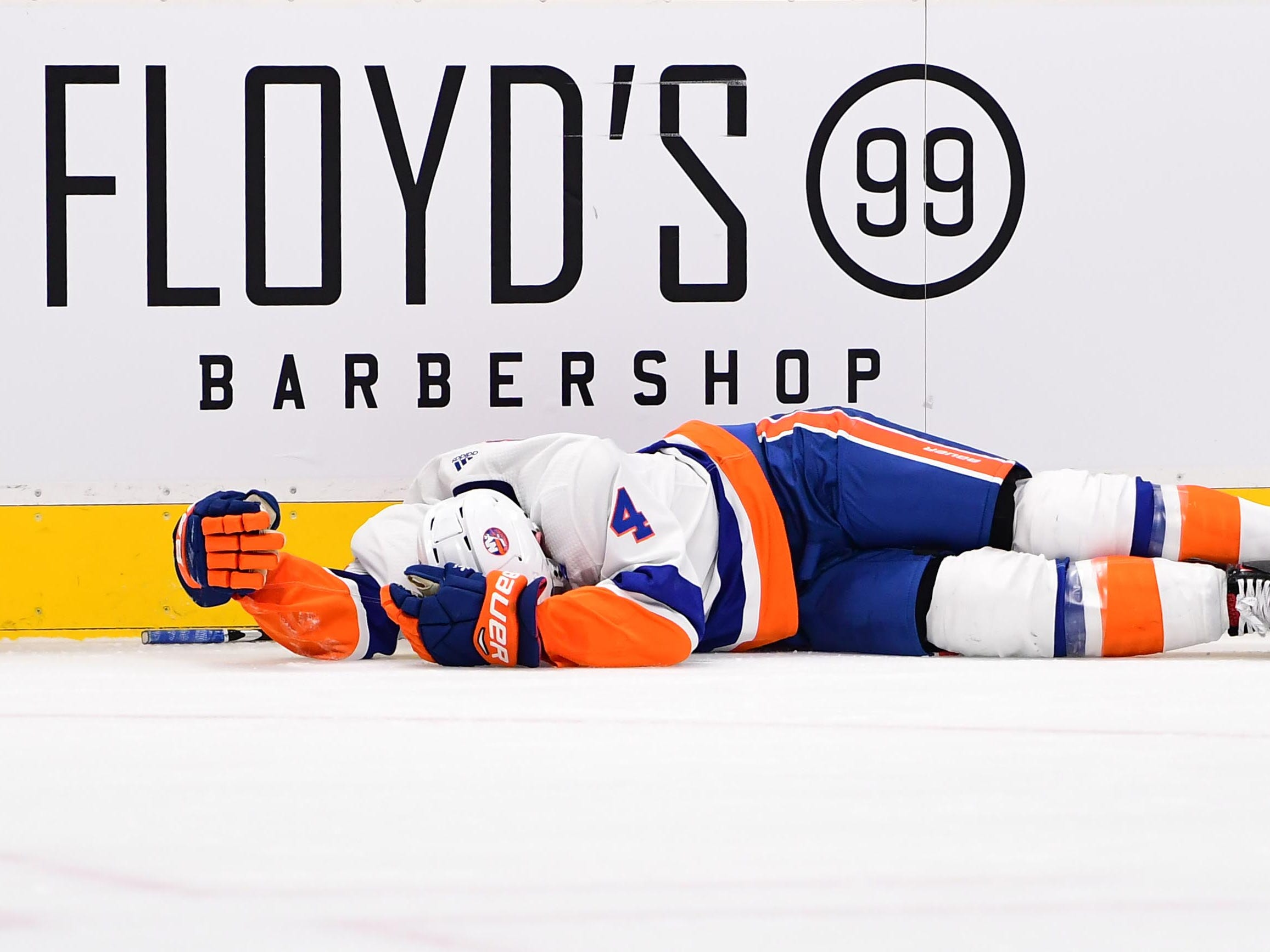 Dec. 17: New York Islanders defenseman Thomas Hickey lies on the ice after crashing hard into the boards. He had to be helped to the dressing room and didn't return.