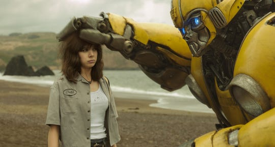 """Charlie IHailee Steinfeld) makes friends with an Autobot in """"Bumblebee."""""""