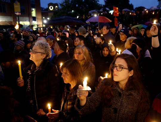 People hold candles as they gather for a vigil in the aftermath of a deadly shooting at the Tree of Life Congregation, in the Squirrel Hill neighborhood of Pittsburgh, Oct. 27, 2018.