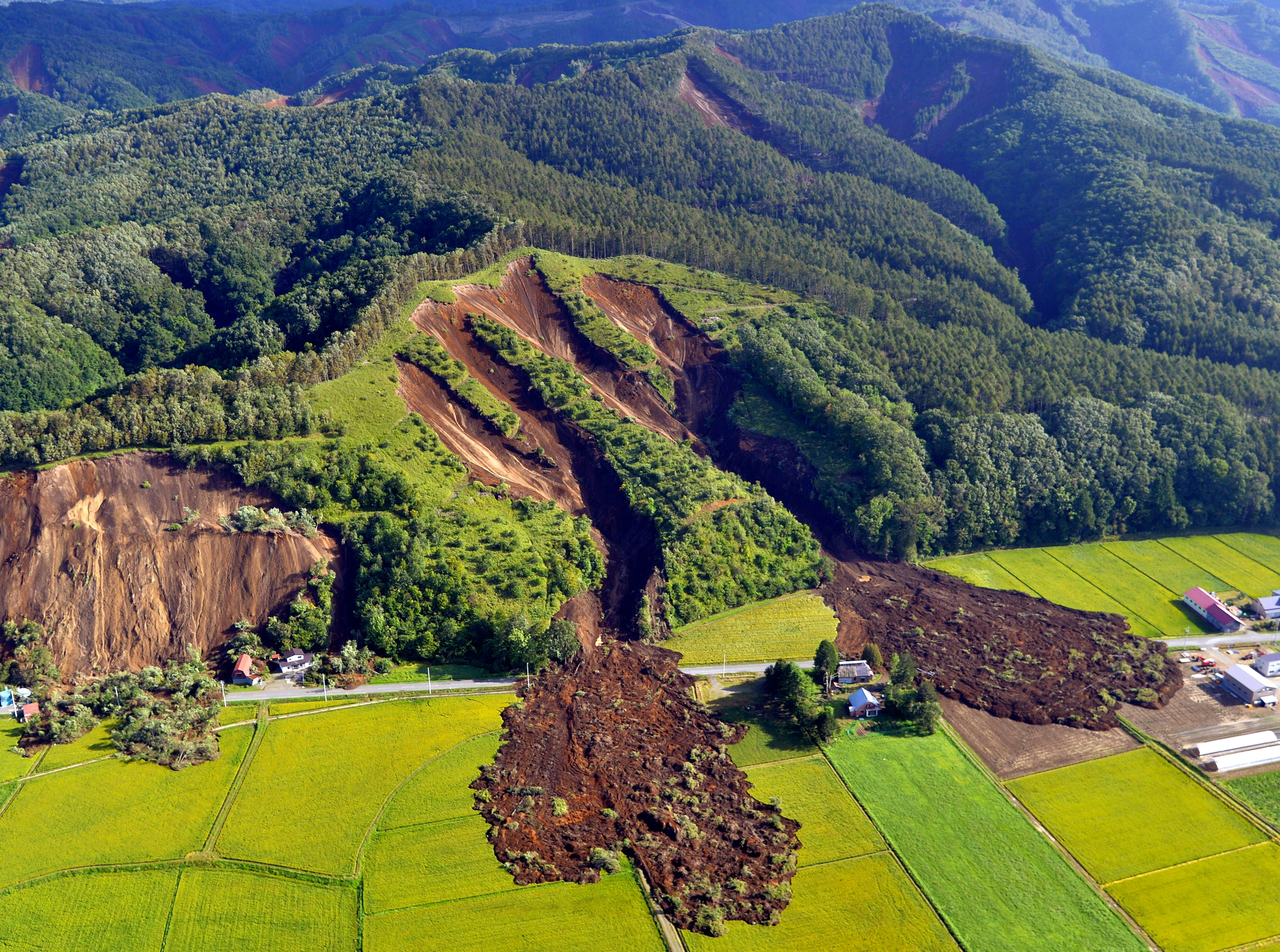 Sept. 6, 2018: An aerial photo shows the aftermath of a large landslide that occurred after an earthquake hit Hokkaido, in Atsuma,  Japan. According to the Japan Meteorological Agency, a strong earthquake of 6.7 magnitude jolted Japan's northern island of Hokkaido in the early hours of Sept. 6, causing large landslides and blackouts.