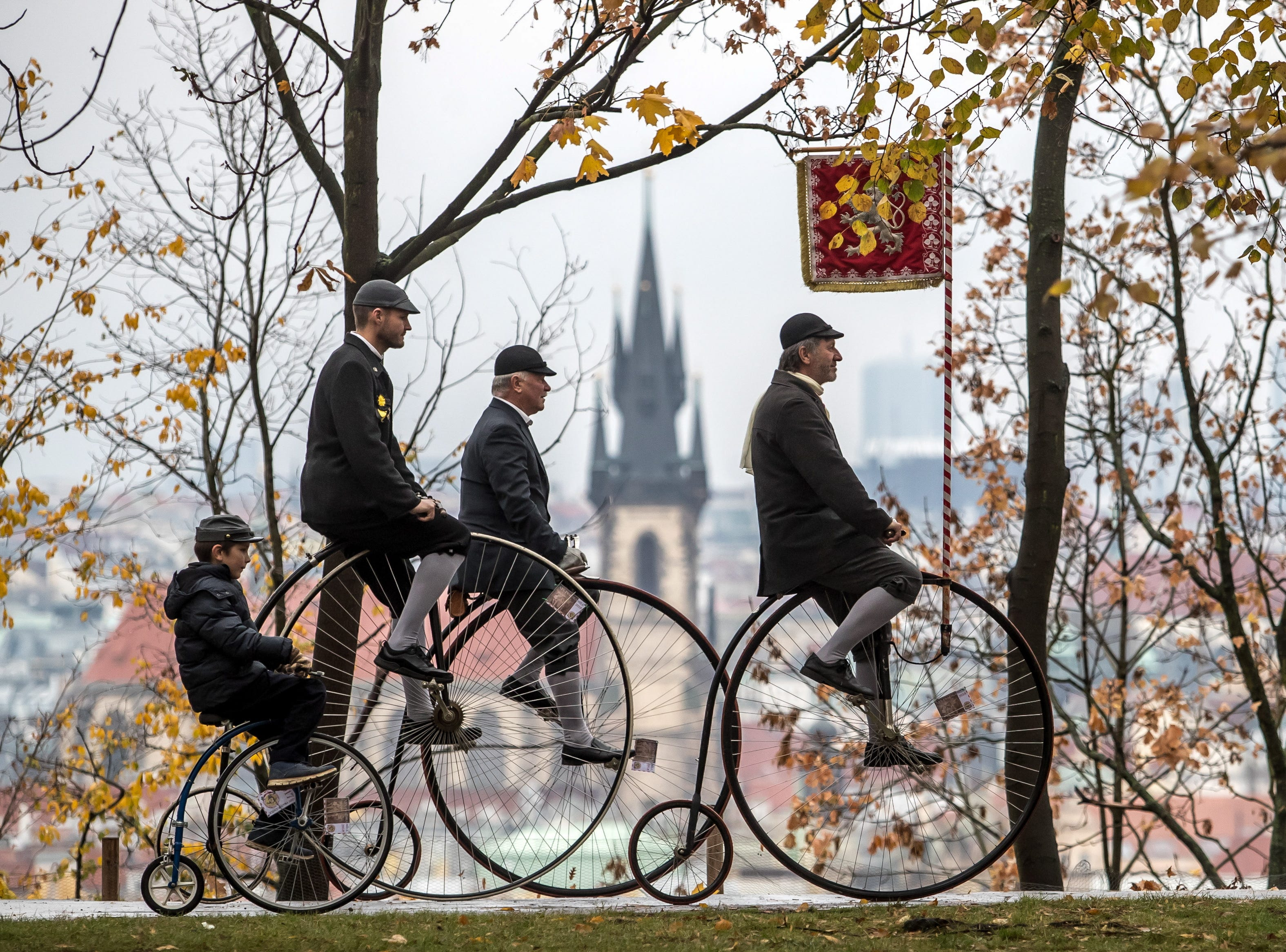 Participants wearing historical dress ride their high-wheels during the traditional 'Prague Mile' race, in Prague, Czech Republic on Nov. 3, 2018.