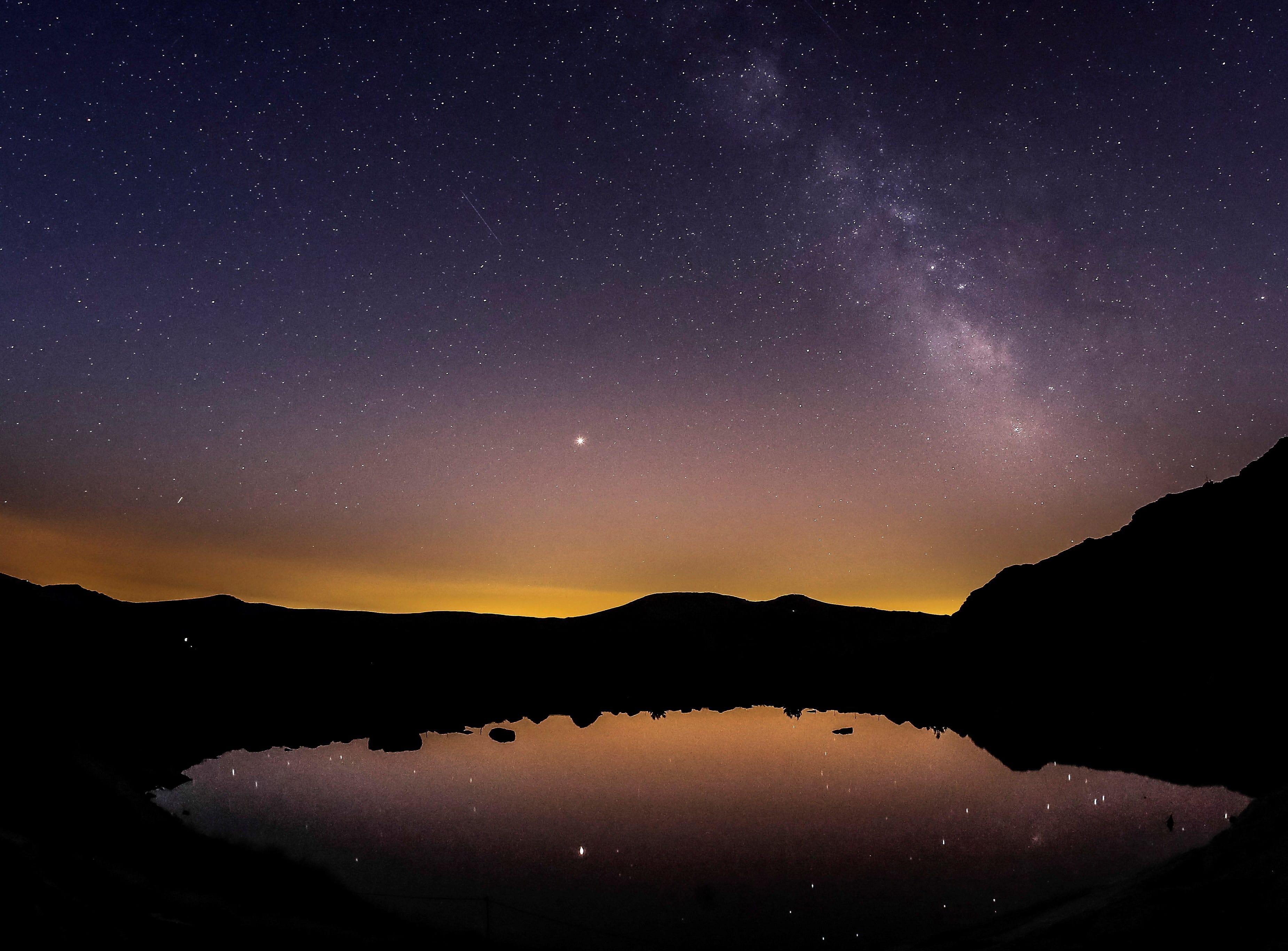 Aug. 15, 2018: View of the Milky Way at dawn at the Penalara Lagoon in Madrid, Spain.