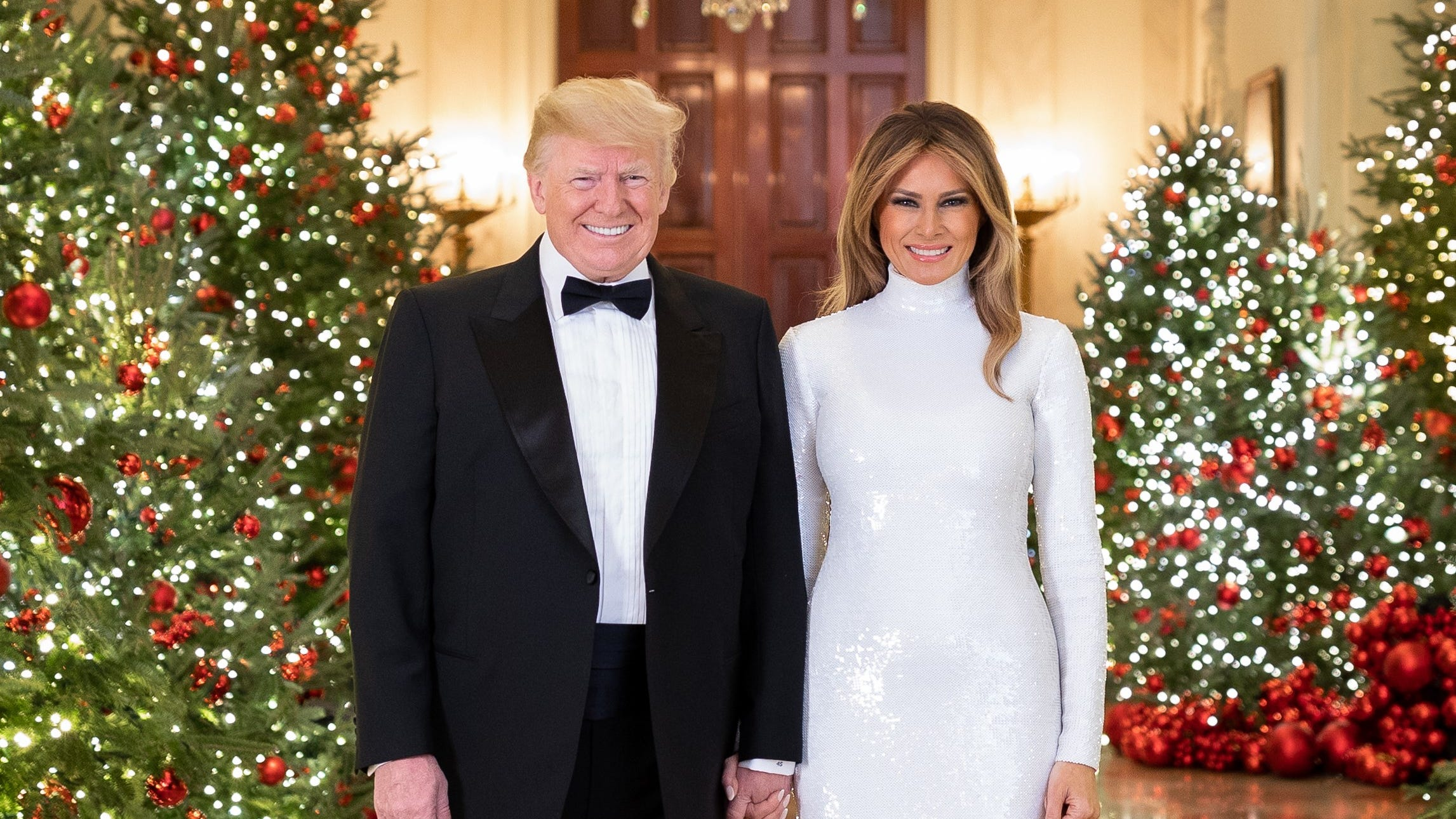 Washington, D.C. President Donald J. Trump and First Lady Melania Trump are seen in their Official Christmas Portrait in the Cross Hall of the White House.