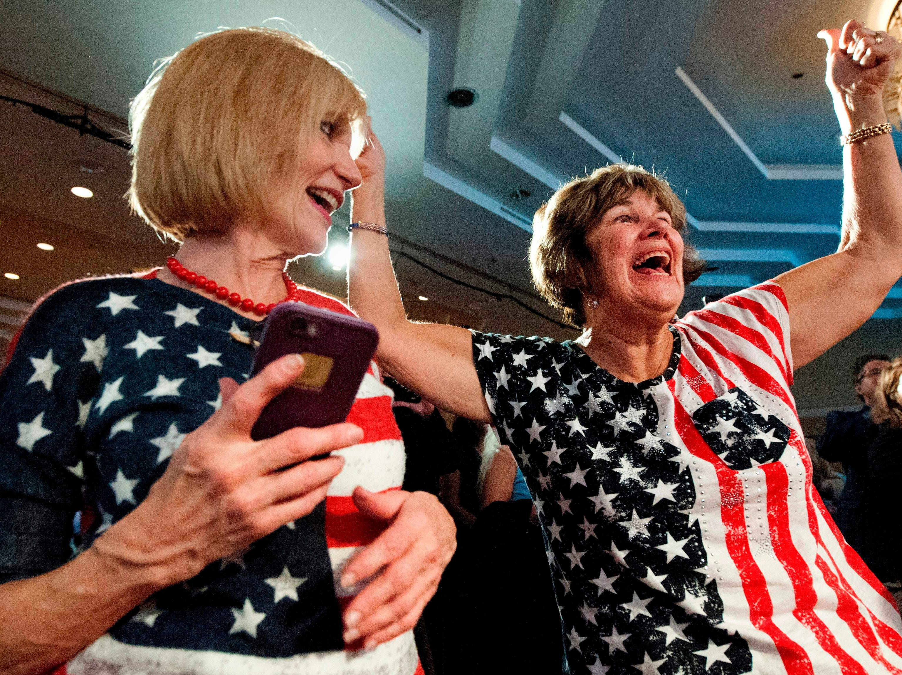 Karen Magnuson (L) and Karen Shaw celebrate after the announcement of the victory of Jason Crow, Democratic candidate for Colorado's 6th congressional District, during the Colorado Democrats watch party in Denver, Colorado, on Nov. 6, 2018.