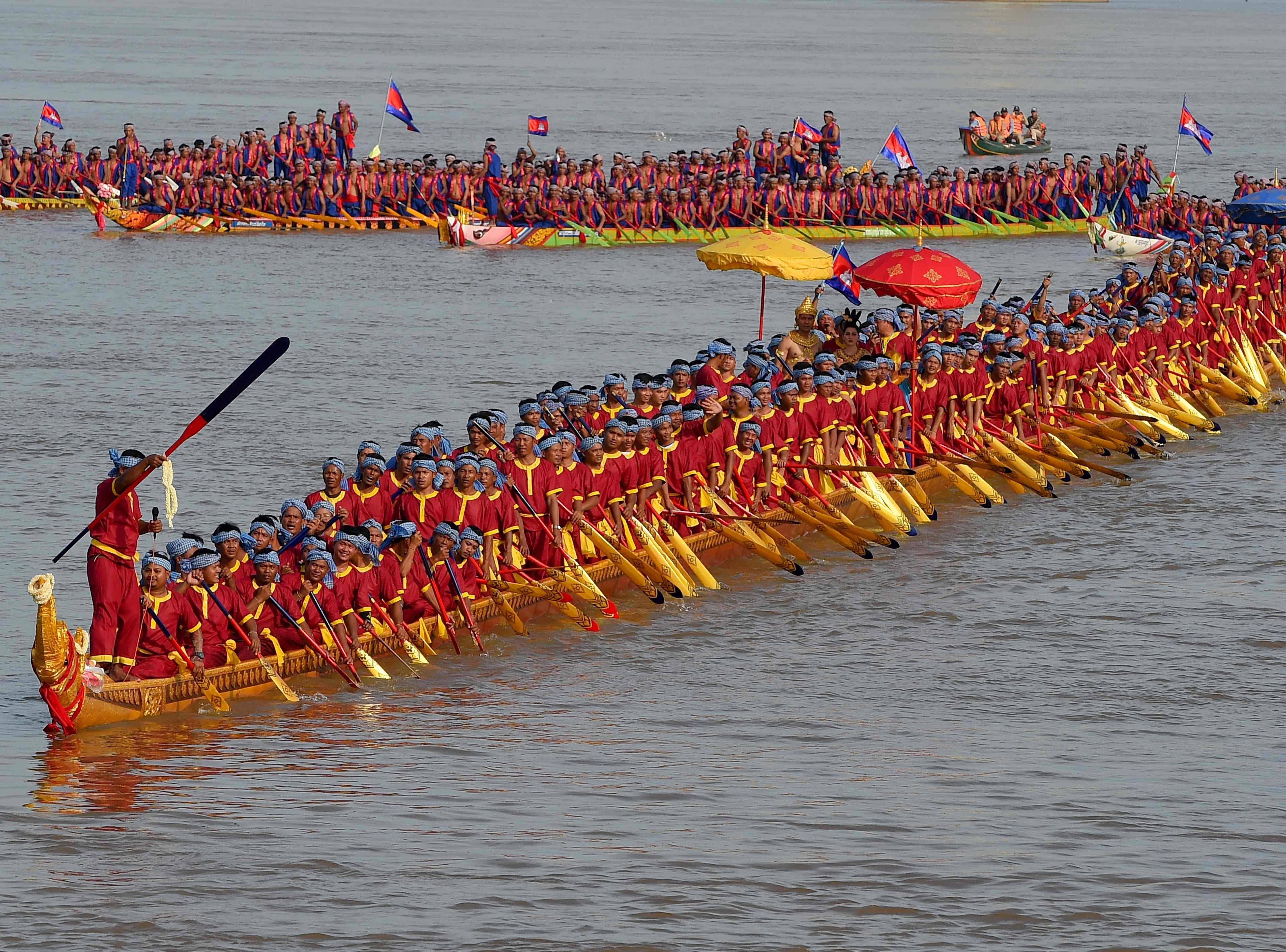 The world's longest dragon boat carrying 179 rowers sails along the Mekong river during a ceremony in Prey Veng, Cambodia on Nov. 12, 2018.