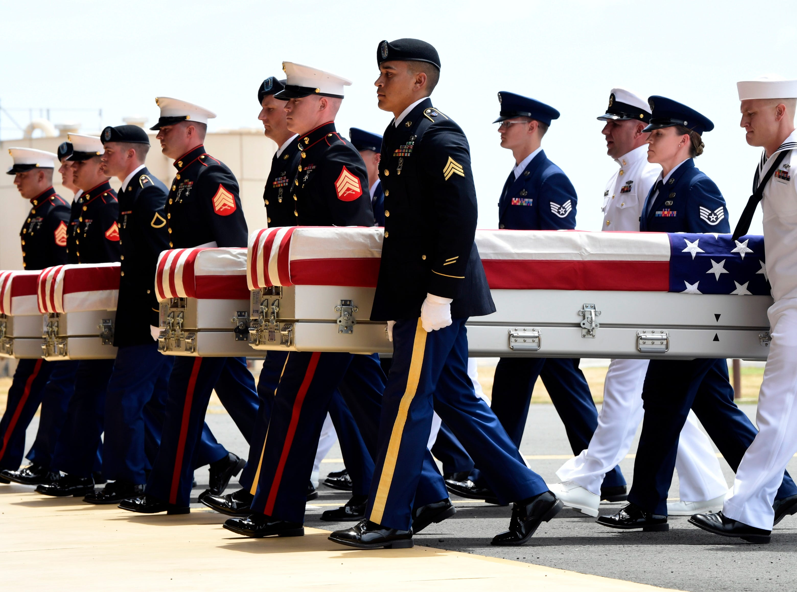 Aug. 1, 2018: Military members carry transfer cases from a C-17 at a ceremony marking the arrival of the remains believed to be of American service members who fell in the Korean War at Joint Base Pearl Harbor-Hickam in Hawaii. North Korea handed over the remains in late July.