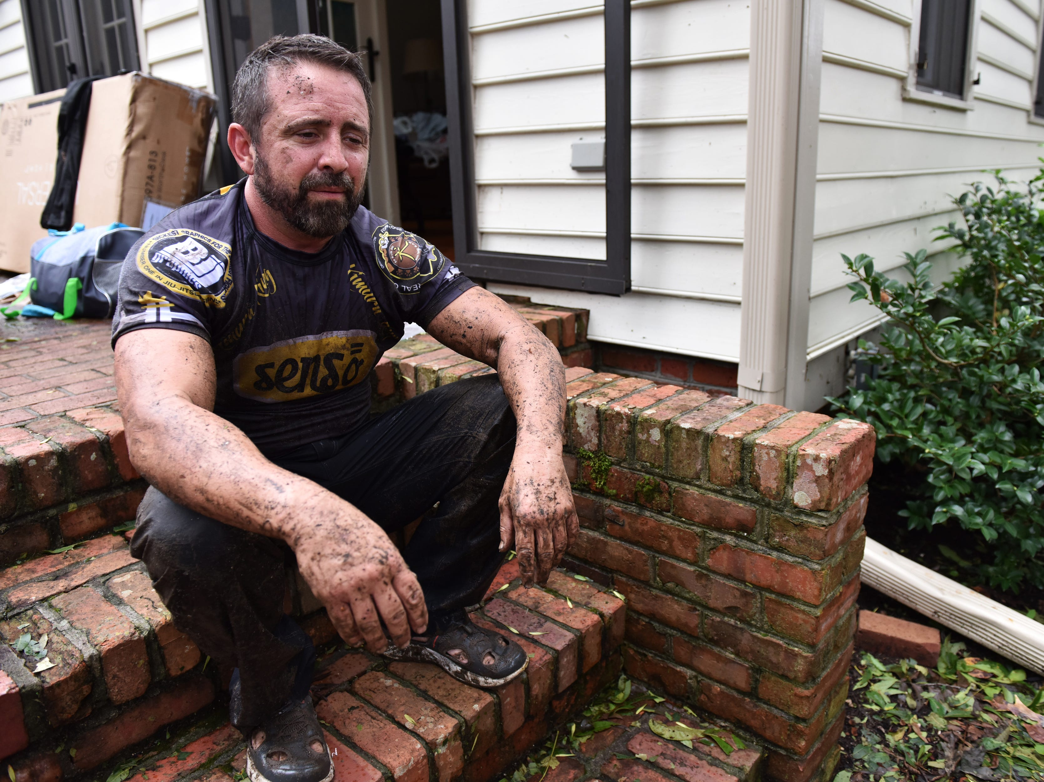 Sept. 16, 2018: Jay Singleton, 46, of New Bern N.C. takes a break after removing all the insulation from the basement in his home that was built in 1810 in the historic neighborhood of New Bern, N.C. Flood waters filled his basement and brought in one foot of water into the first floor. Hurricane Florence brought heavy rain and winds causing flooding in North and South Carolinas.