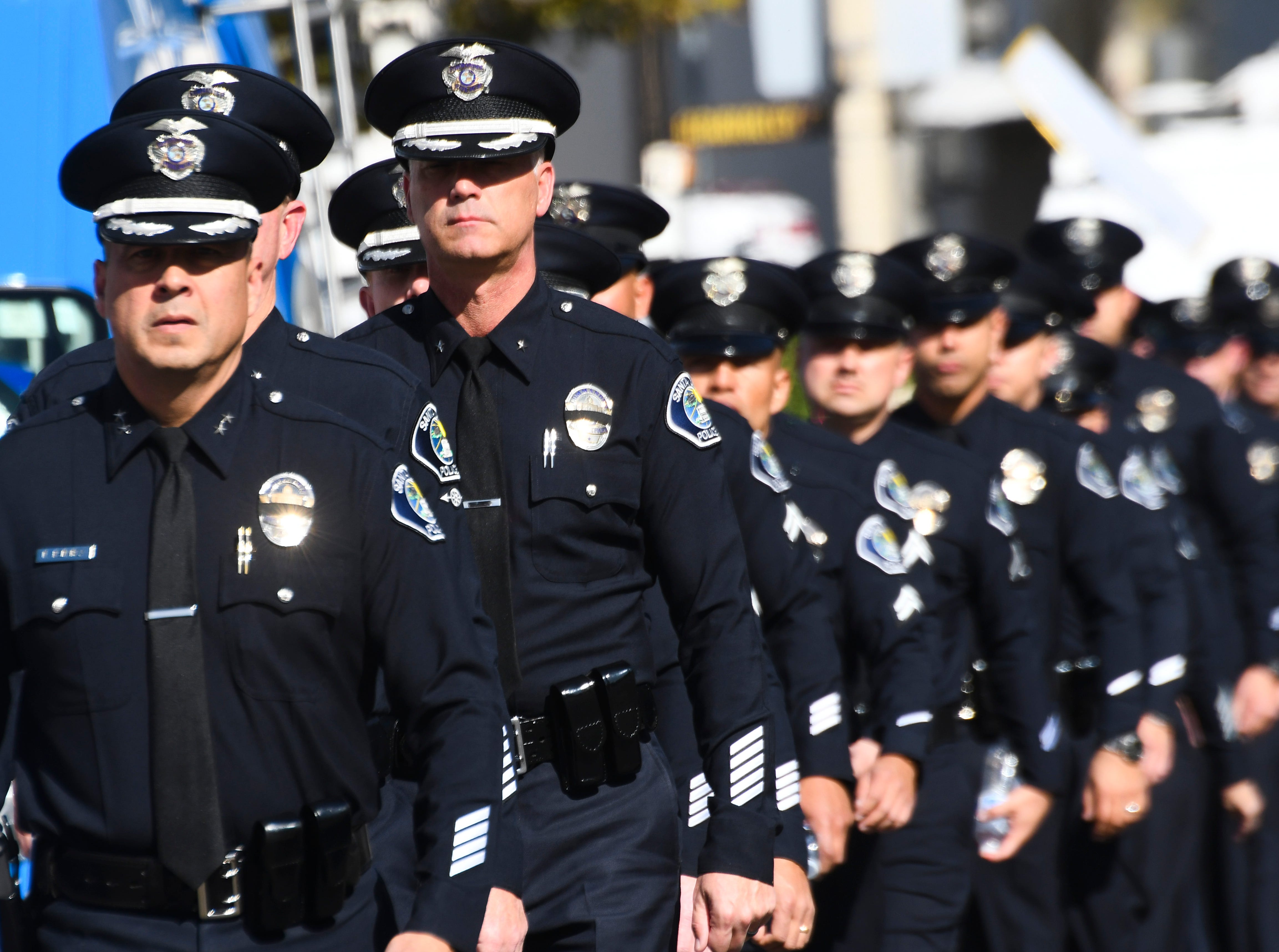 Santa Ana police officers walks to the Calvary Community Church in Ventura, Calif. on Nov. 15, 2018 for the funeral service for Ventura County Sheriff's Sgt. Ron Helus who was killed in the mass shooting at the Borderline Bar and Grill on Nov. 7, 2018.