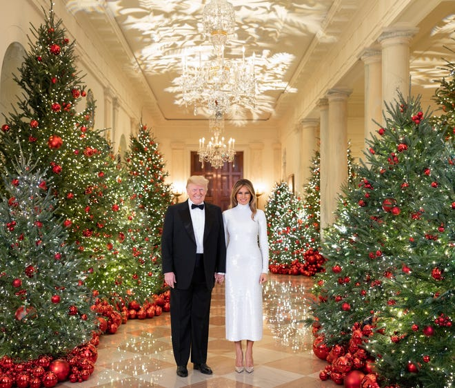 2020 Christmas Portrait Of Trump And Melania Donald Trump, Melania hold hands in official Christmas portrait