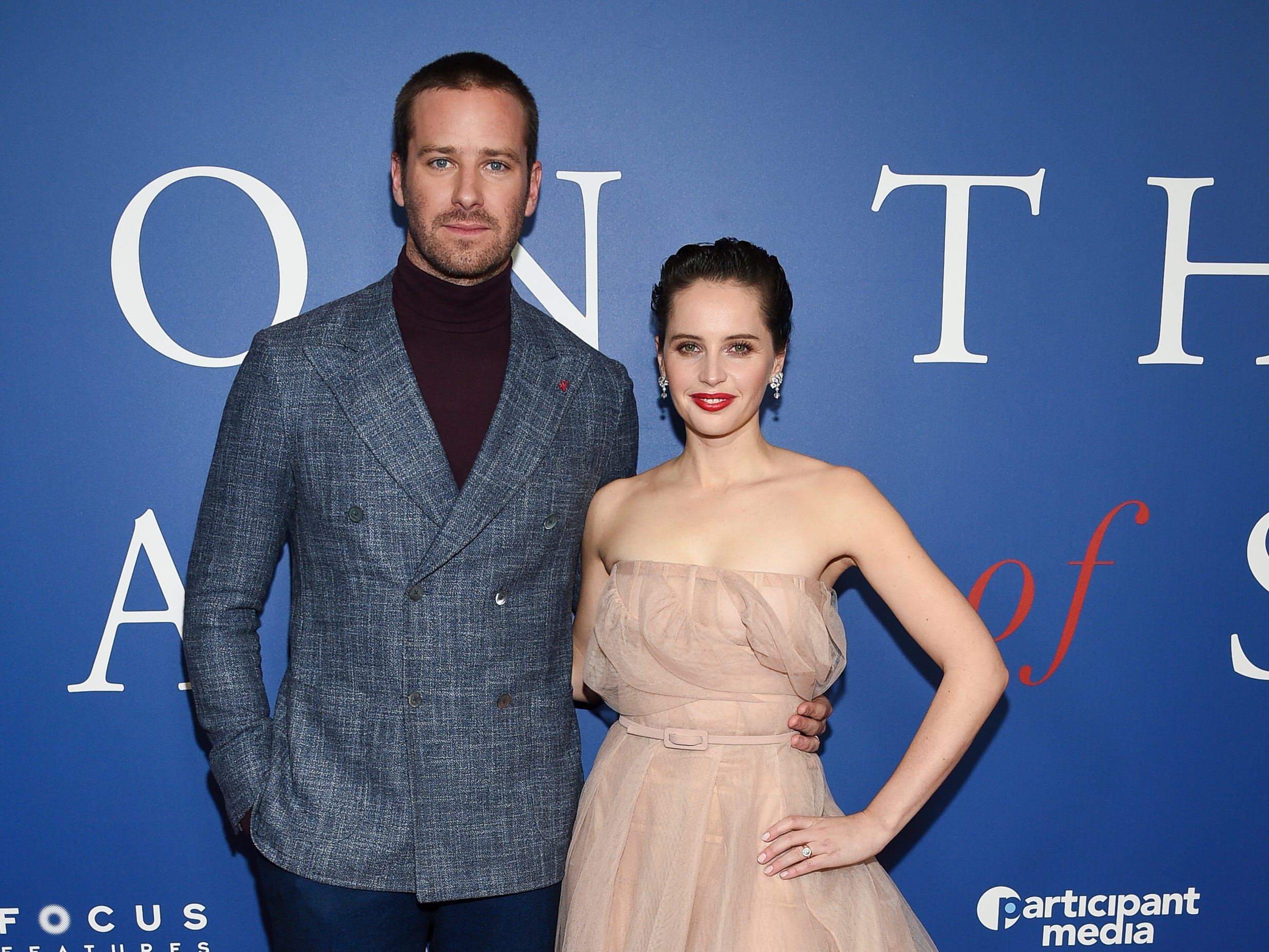 """Actors Armie Hammer, left, and Felicity Jones pose together at a special screening of """"On The Basis of Sex"""" at the Walter Reade Theater on Sunday, Dec. 16, 2018, in New York. (Photo by Evan Agostini/Invision/AP) ORG XMIT: NYEA0110"""