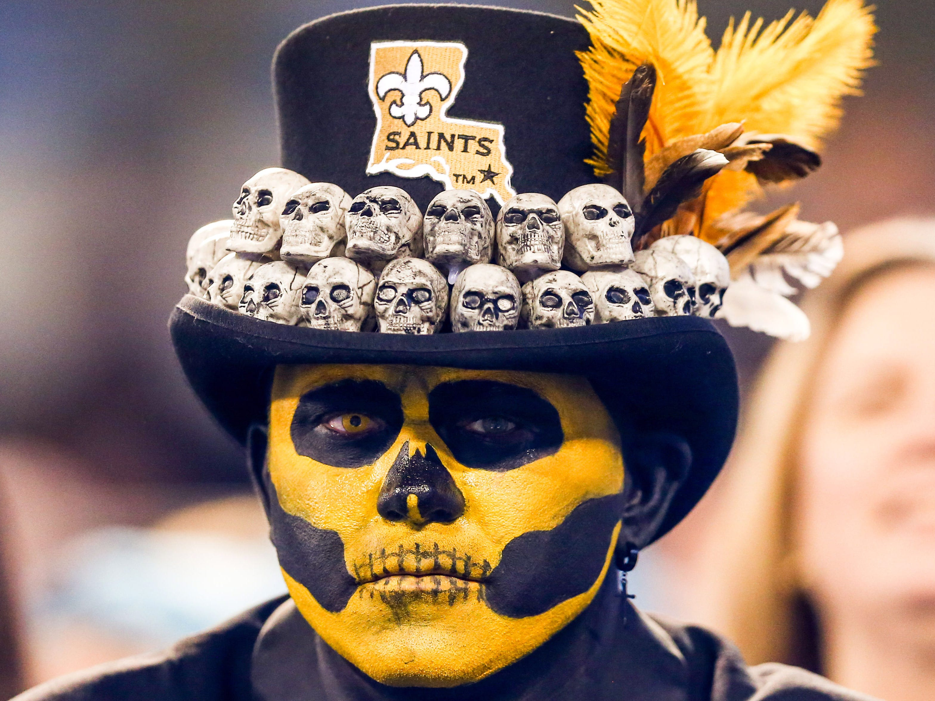 A New Orleans Saints fan looks on during the game against the Carolina Panthers at Bank of America Stadium.