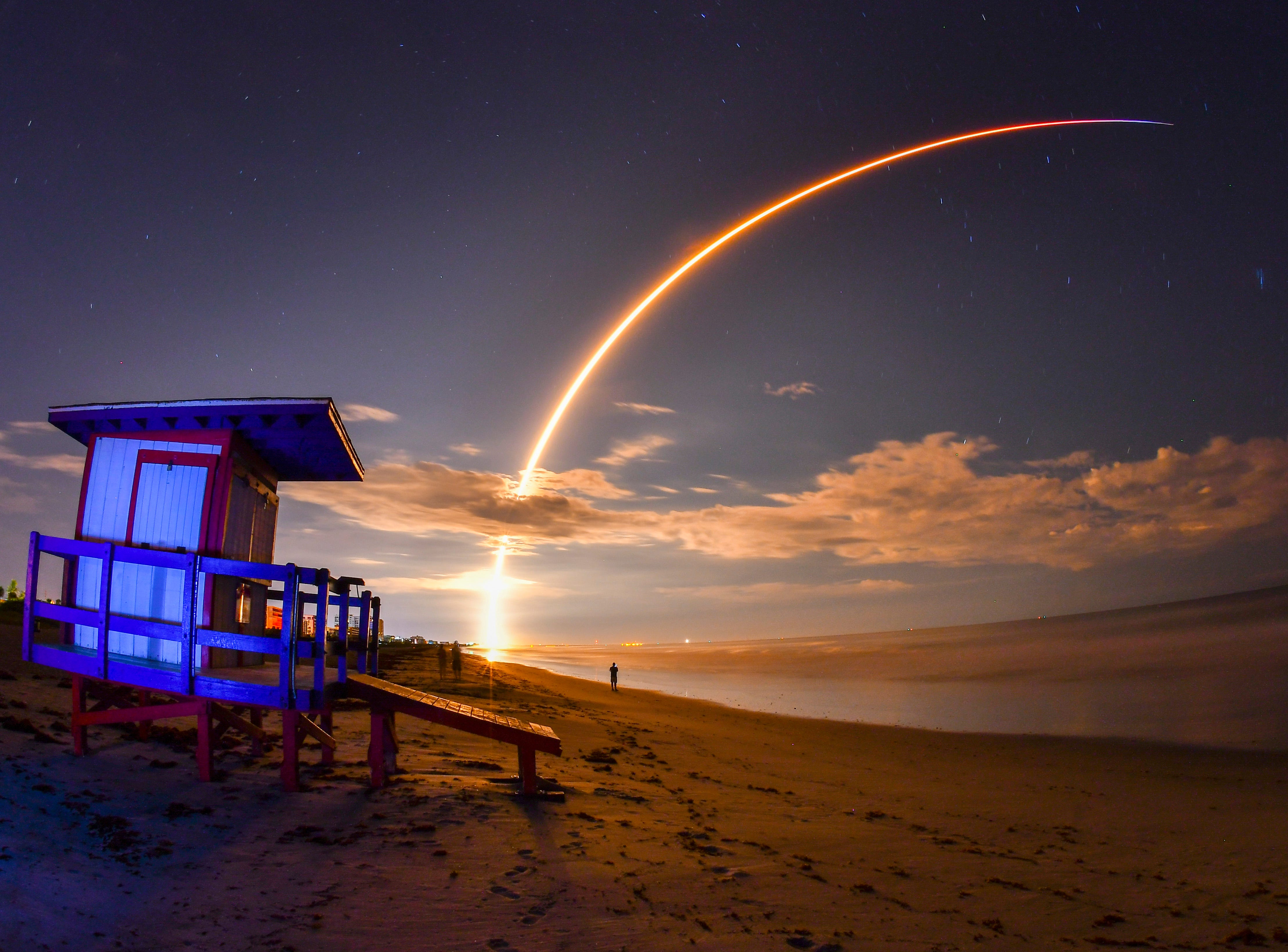Sept. 9, 2018: The early morning launch of Telesat's Telstar 18 Vantage communications satellite on a SpaceX Falcon 9 rocket, launched form Launch Complex 40 at Cape Canaveral Air Force Station, viewed from Minutemen Causeway in Cocoa Beach. The photo is a 145 second time exposure of the launch with a lifeguard station in the foreground.