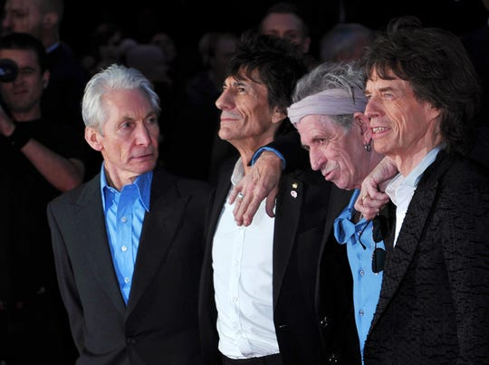 """In this 2012 file photo, The Rolling Stones pose on the red carpet as they arrive for the premiere of """"Crossfire Hurricane,"""" a documentary about the rock group, in London's Leicester Square. The band is headlining the 2019 New Orleans Jazz and Heritage Festival."""