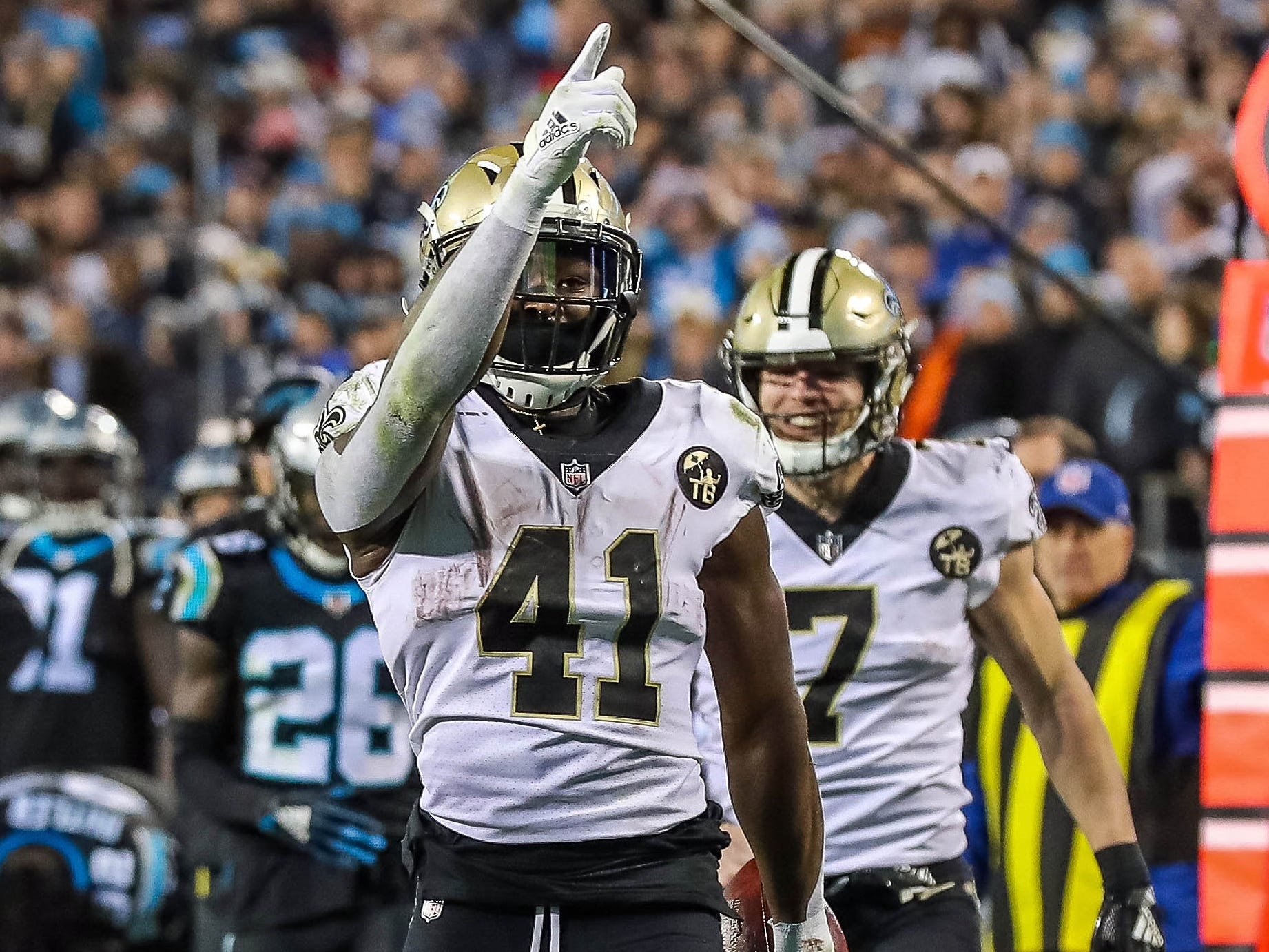 New Orleans Saints running back Alvin Kamara reacts to his first down run against the Carolina Panthers during the second half at Bank of America Stadium.