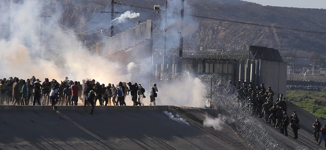 View of tear gas that border police use to prevent groups of people from crossing El Chaparral border crossing, in the city of Tijuana, Mexico,  Nov. 25, 2018.
