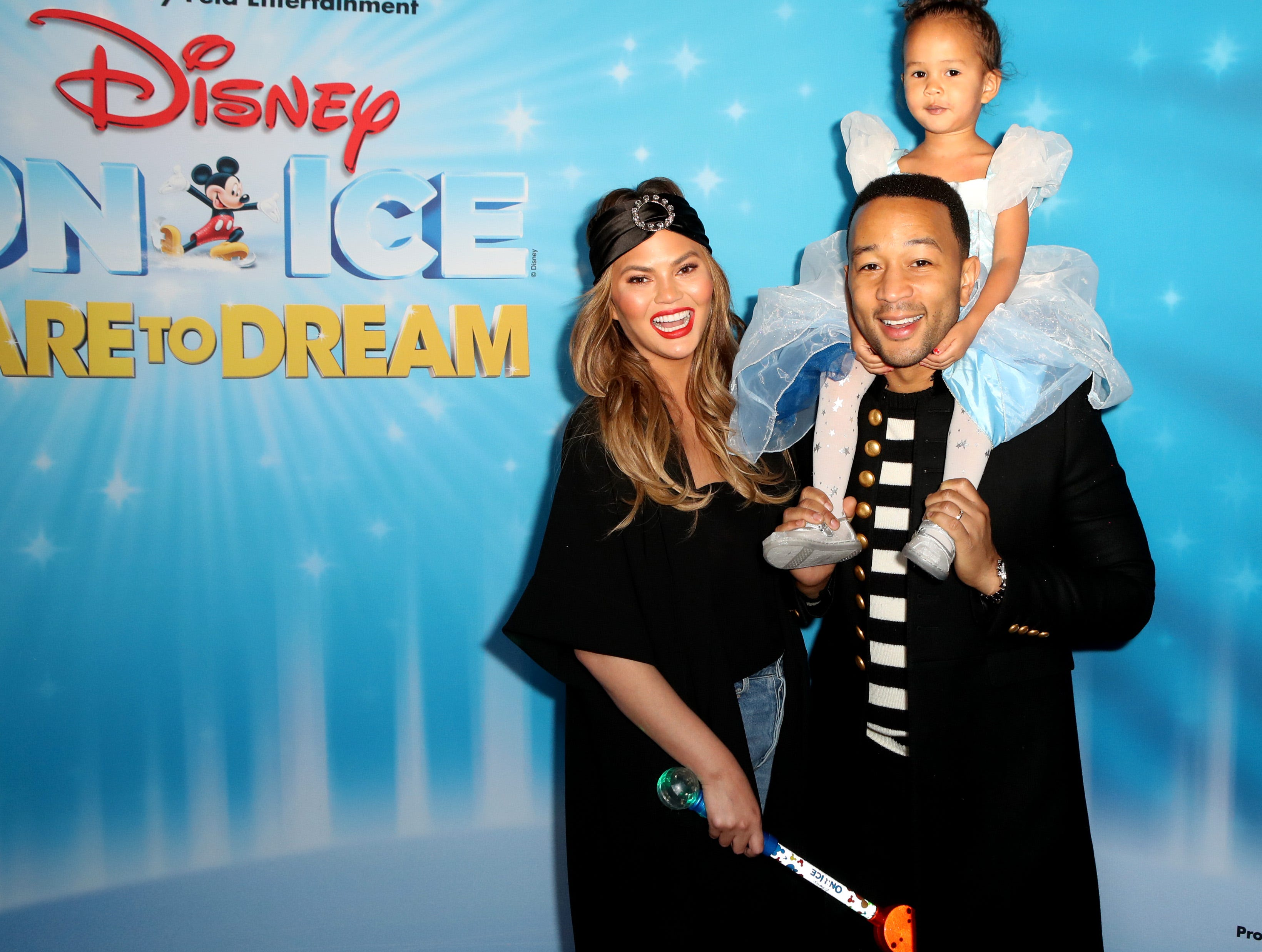 UNSPECIFIED,  - JANUARY 01: Chrissy Teigen, John Legend and daughter Luna attend Disney On Ice Presents Dare to Dream Celebrity Skating Party at Staples Center on December 14, 2018 in Los Angeles, California. (Photo by Ari Perilstein/Ari Perilstein / Getty Images for Feld Entertainment, Inc) ORG XMIT: 775231180 ORIG FILE ID: 1082728010