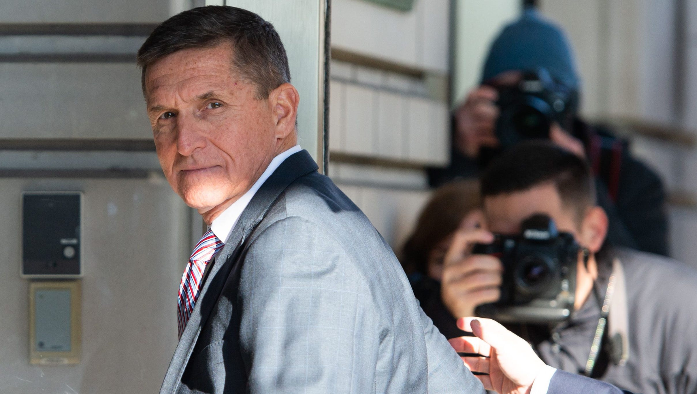 Former national security adviser Michael Flynn arrives for his sentencing hearing at federal court in Washington, Dec. 18, 2018.