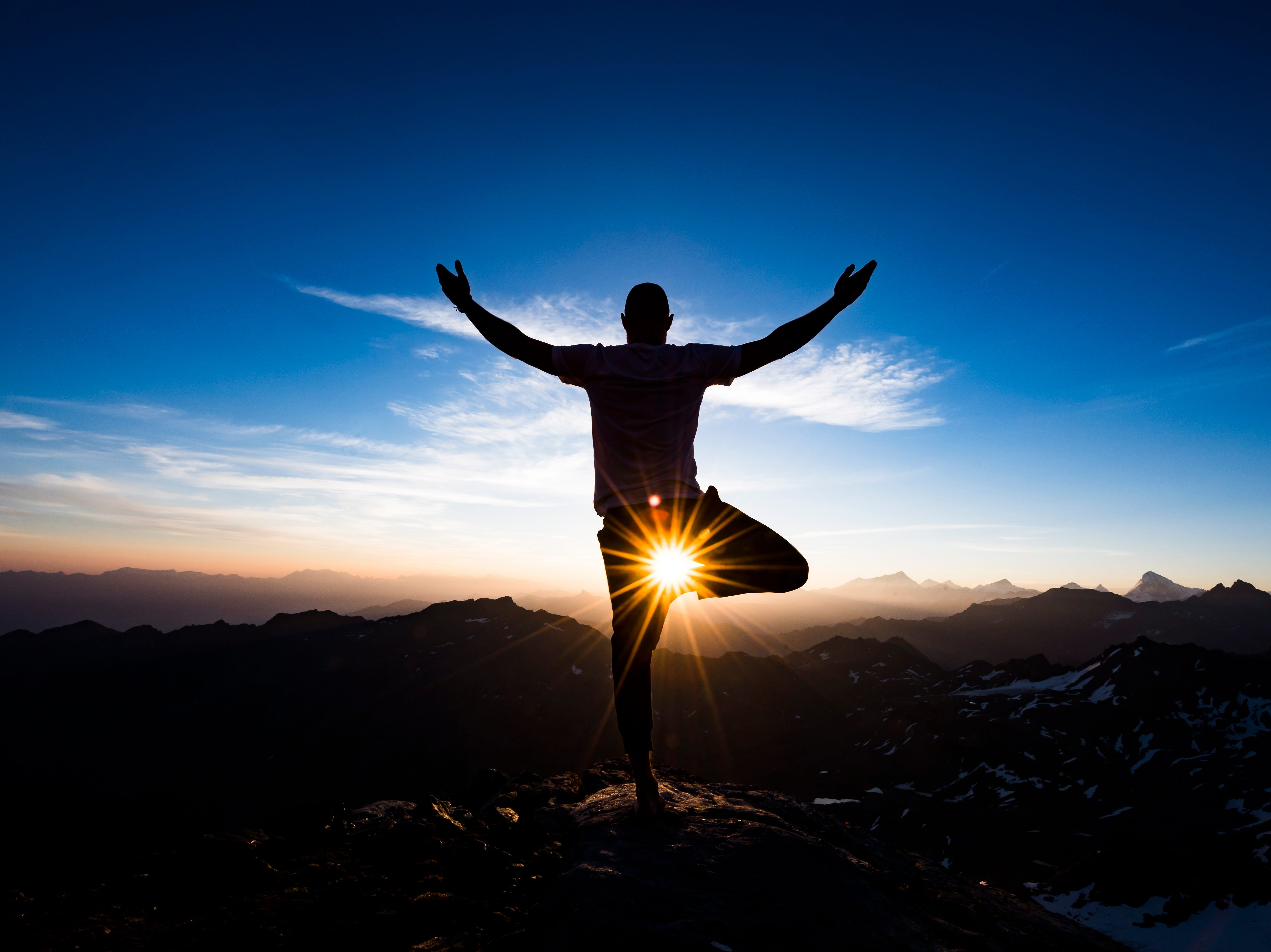 Aug. 2, 2018: Emilien Badoux, swiss freerider and Yoga teacher practices Yoga at sunrise on the top of Mont Fort peak surrounded by Swiss Alps, between Nendaz and Verbier, Switzerland.