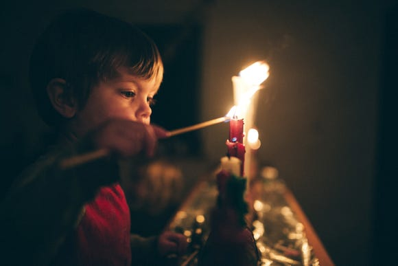 Don't ignore the loss of a loved one during the holidays. Instead, remember their life in ways that are meaningful to your family, such as lighting a candle in remembrance.