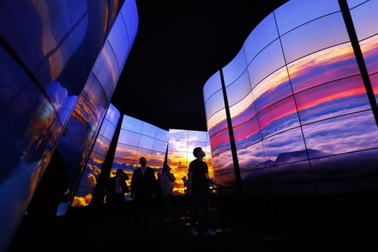 Aug. 30, 2018: Visitors look at the LG Oled Screen installation at the 2018 IFA consumer electronics and home appliances trade fair during the fair's press day in Berlin, Germany.