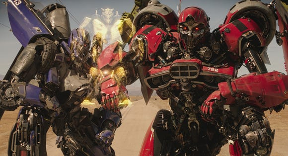 "Dropkick (voiced by Justin Theroux, left) and Shatter (Angela Bassett) scheme to take down the title character of ""Bumblebee."""