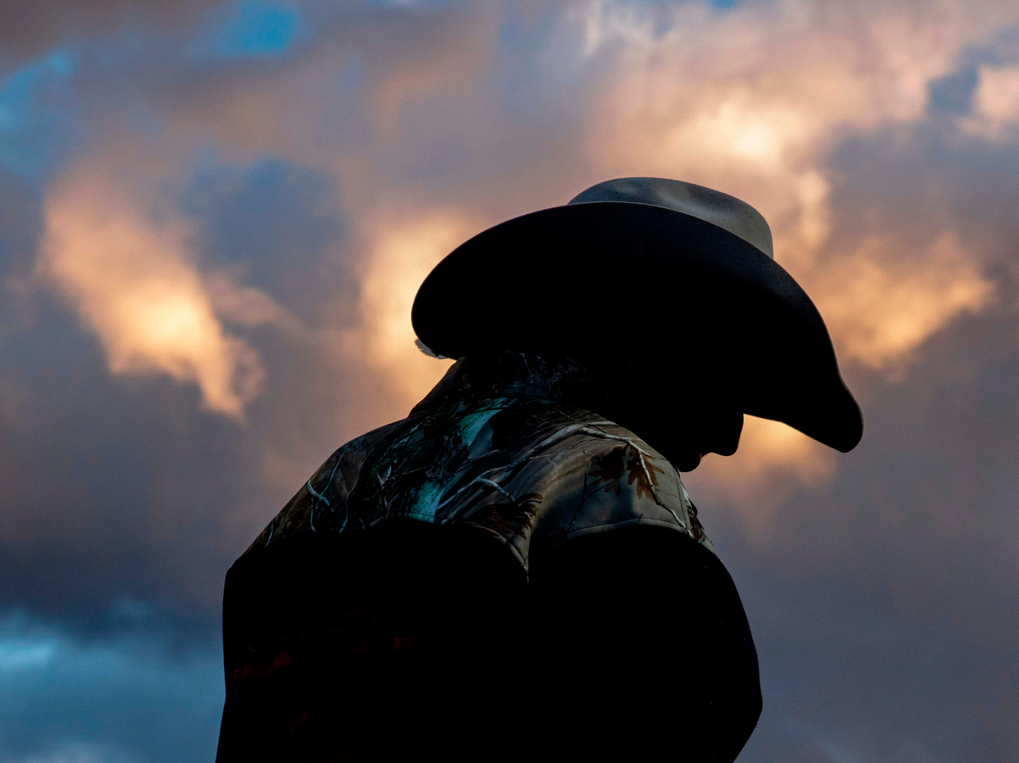 Aug. 22, 2018 : A cowboy watches the rodeo from behind the chute at the Snowmass Rodeo, in Snowmass, Colo.