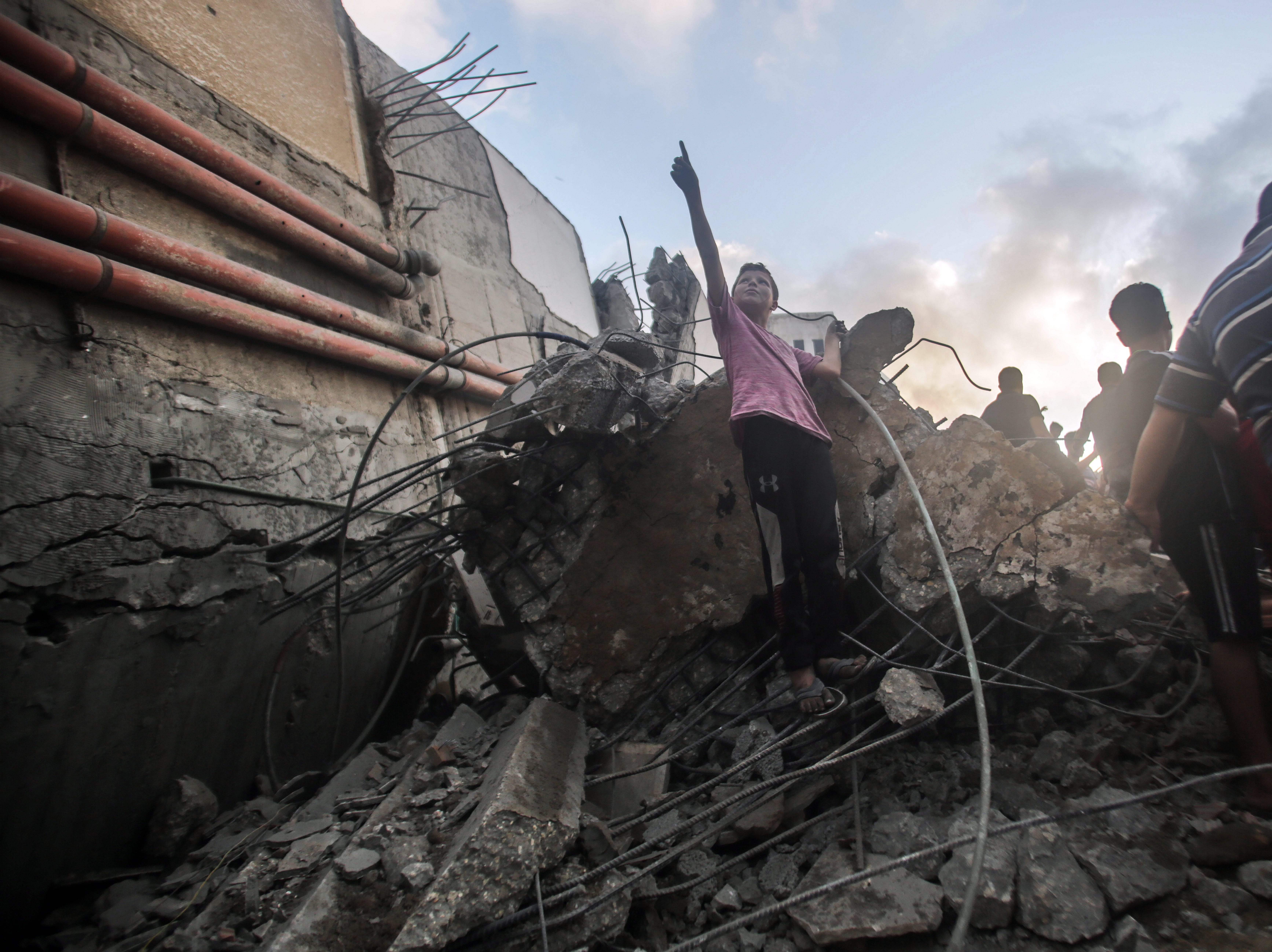 Aug. 9, 2018: Palestinians inspect the Said al-Mishal Cultural Center building destroyed in an Israeli air strike in Gaza City.