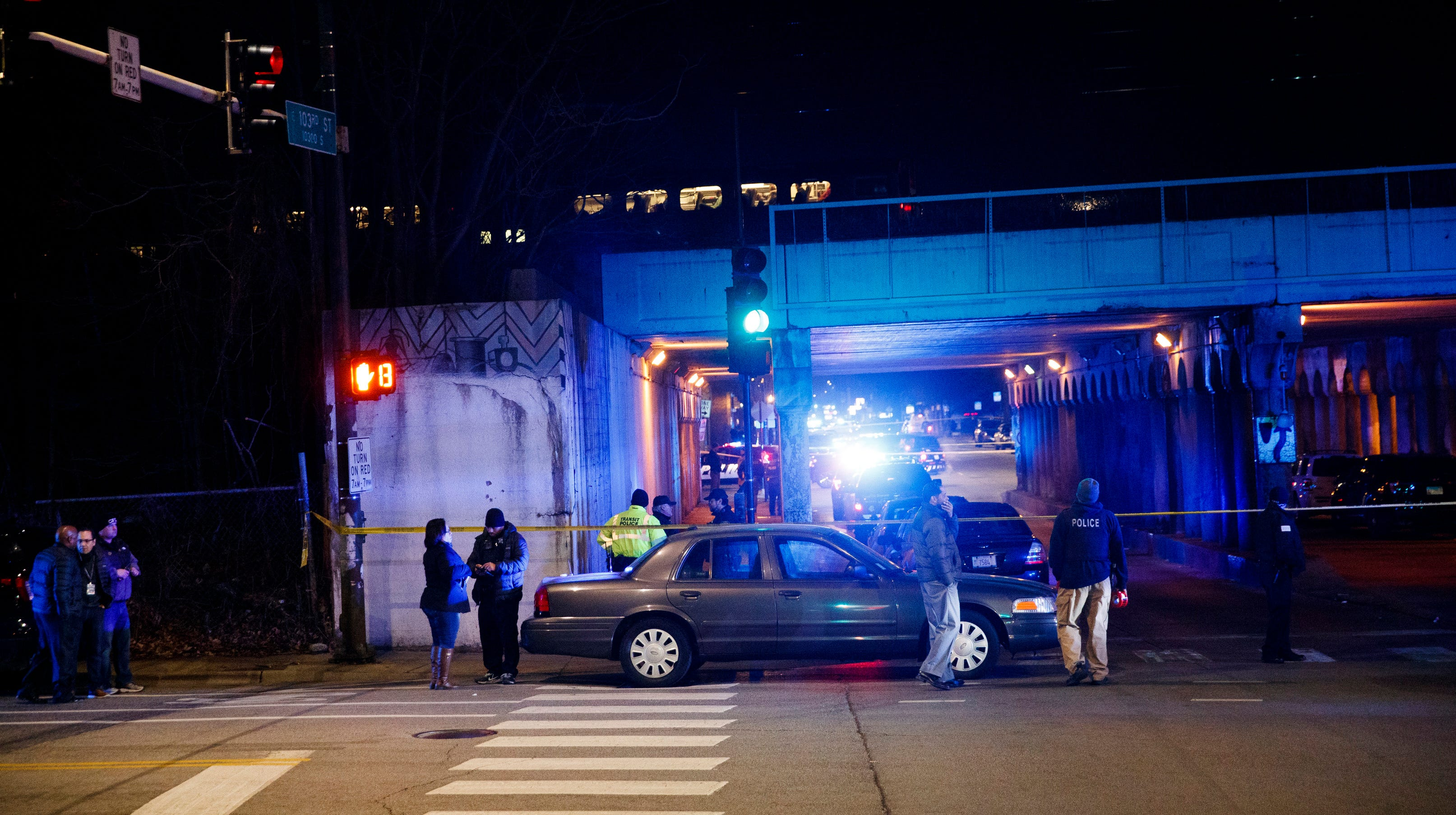 Police investigate the scene where two officers were killed after they were struck by a passenger train on Monday, Dec. 17, 2018, in Chicago. Police said the officers were investigating a shots-fired call when they were struck by gunfire. (Armando L. Sanchez/Chicago Tribune via AP) ORG XMIT: ILCHT101