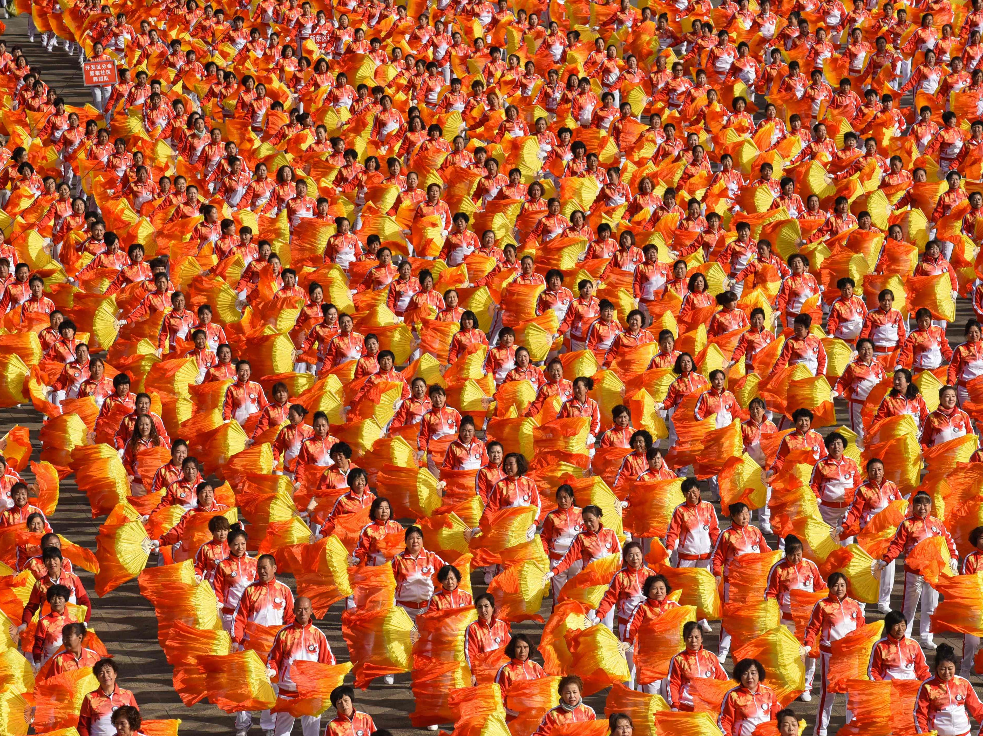 People take part in a mass dance event in Datong in China's northern Shanxi province on Oct. 9, 2018.  Some 20,000 dancers took part in the event.