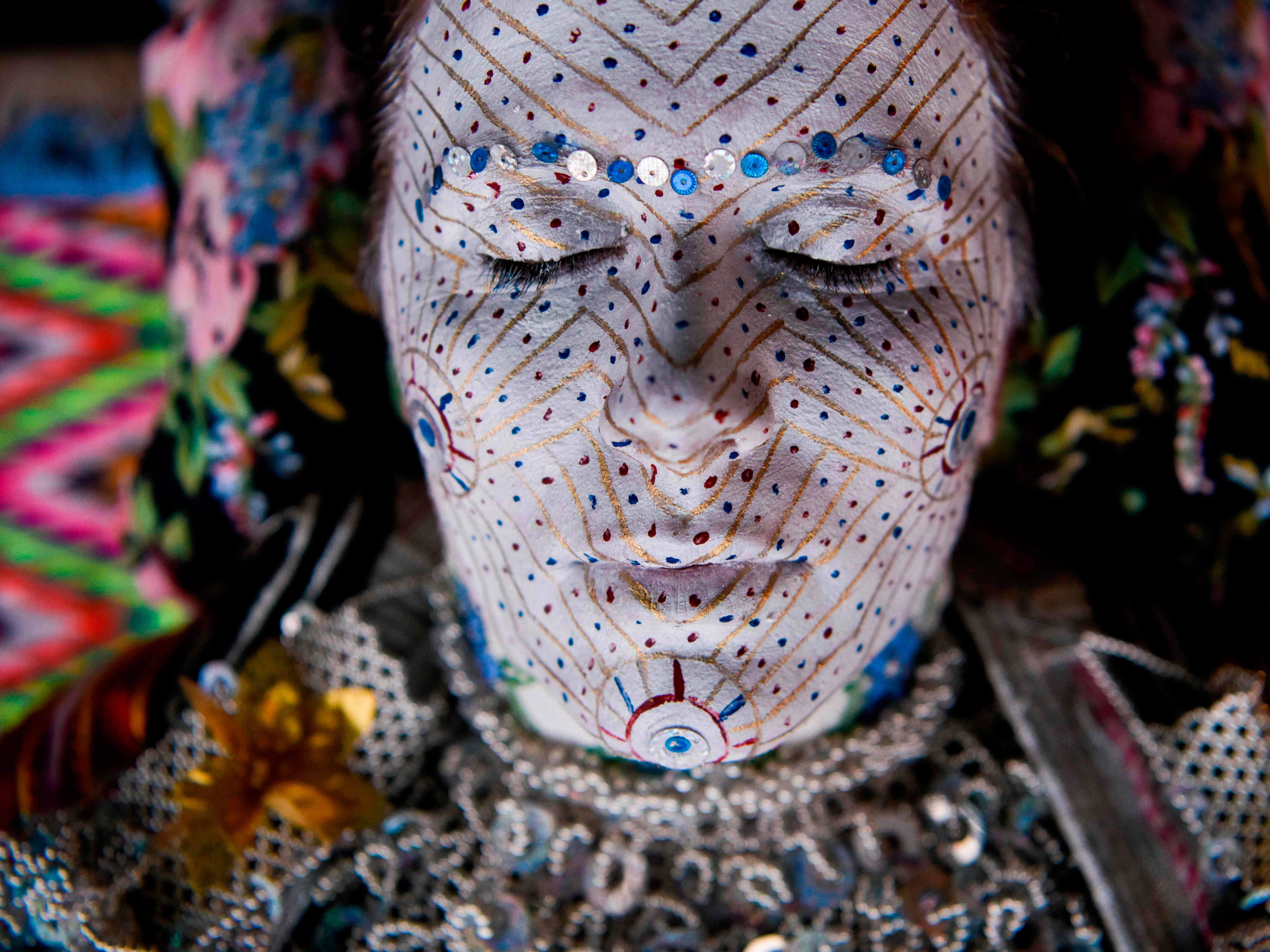 Sept. 5, 2018: Sheqerie Buqaj receives a face painting for a traditional wedding of Bosnian women from the Zhupa region.  As part of the centuries old tradition, old ladies prepare young brides, painting their faces in many layers of colors while the golden circles symbolize the cycles of life.