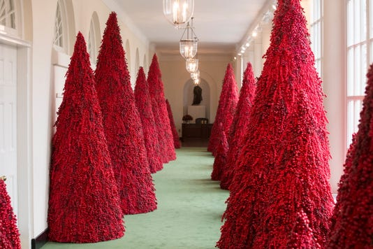 4a531a49 Melania Trump's controversial red trees a hit at Christmas parties