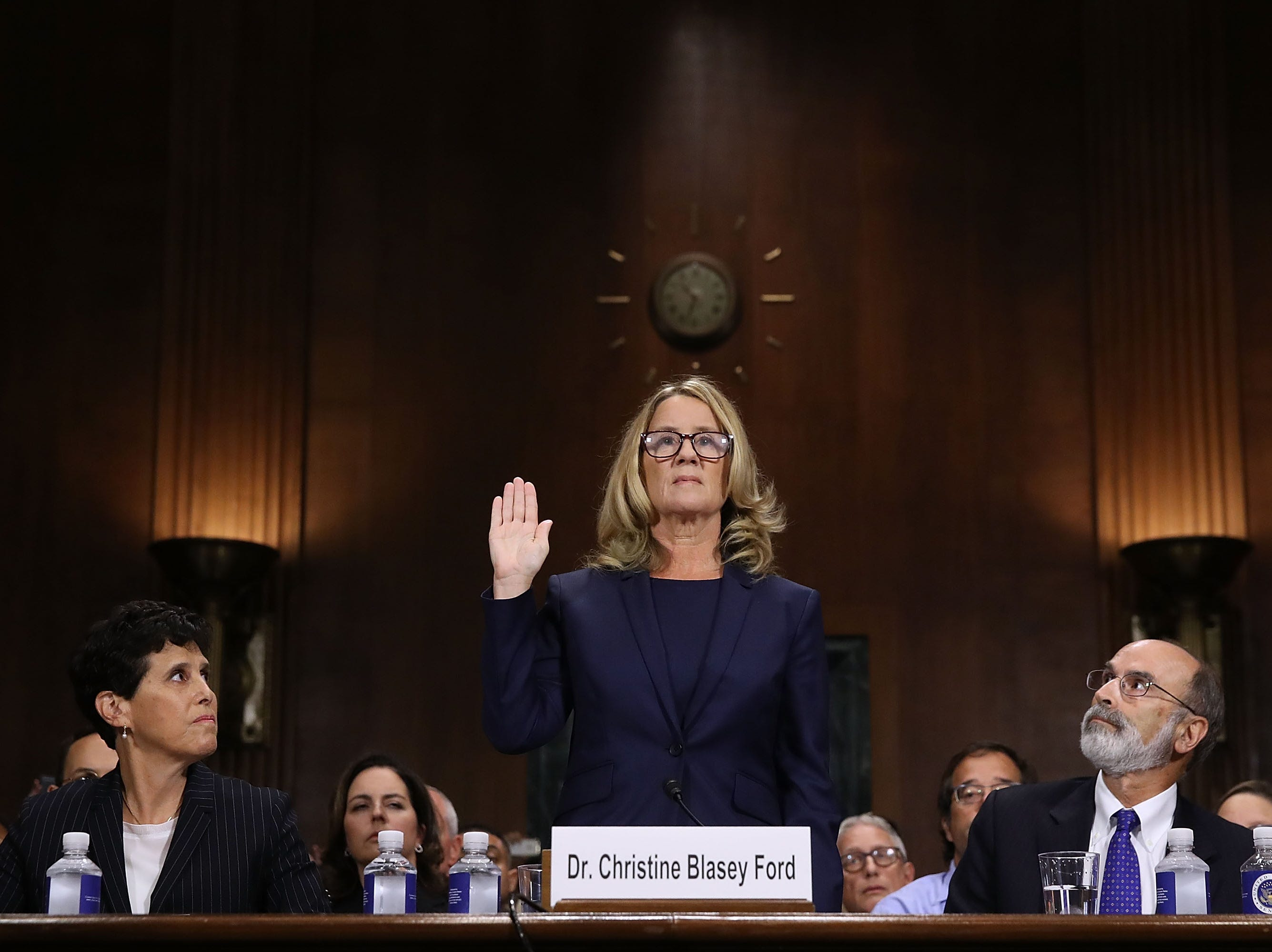 Christine Blasey Ford (C) is sworn in before testifying the Senate Judiciary Committee with her attorneys Debra Katz (L) and Michael Bromwich (R) on Capitol Hill Sept. 27, 2018 in Washington, DC. A professor at Palo Alto University and a research psychologist at the Stanford University School of Medicine, Ford has accused Supreme Court nominee Judge Brett Kavanaugh of sexually assaulting her during a party in 1982 when they were high school students in suburban Maryland. In prepared remarks, Ford said, ÒI donÕt have all the answers, and I donÕt remember as much as I would like to. But the details about that night that bring me here today are ones I will never forget. They have been seared into my memory and have haunted me episodically as an adult.Ó